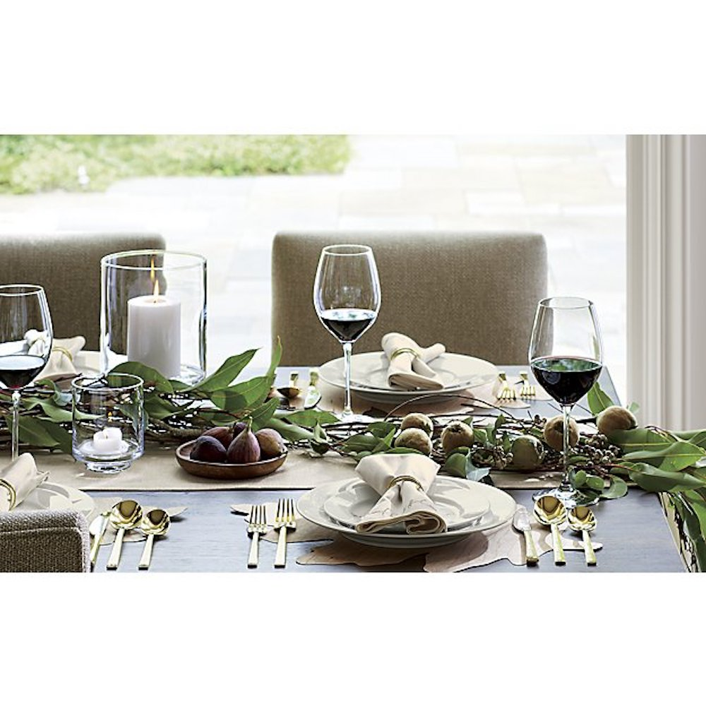Crate & Barrel dishware on set top with greenery