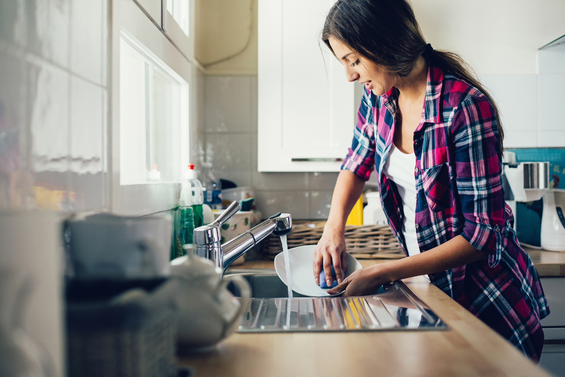 Woman doing dishes wearing button down