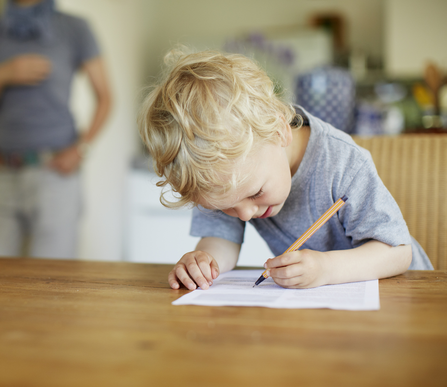Boy writing checklist with pencil and paper