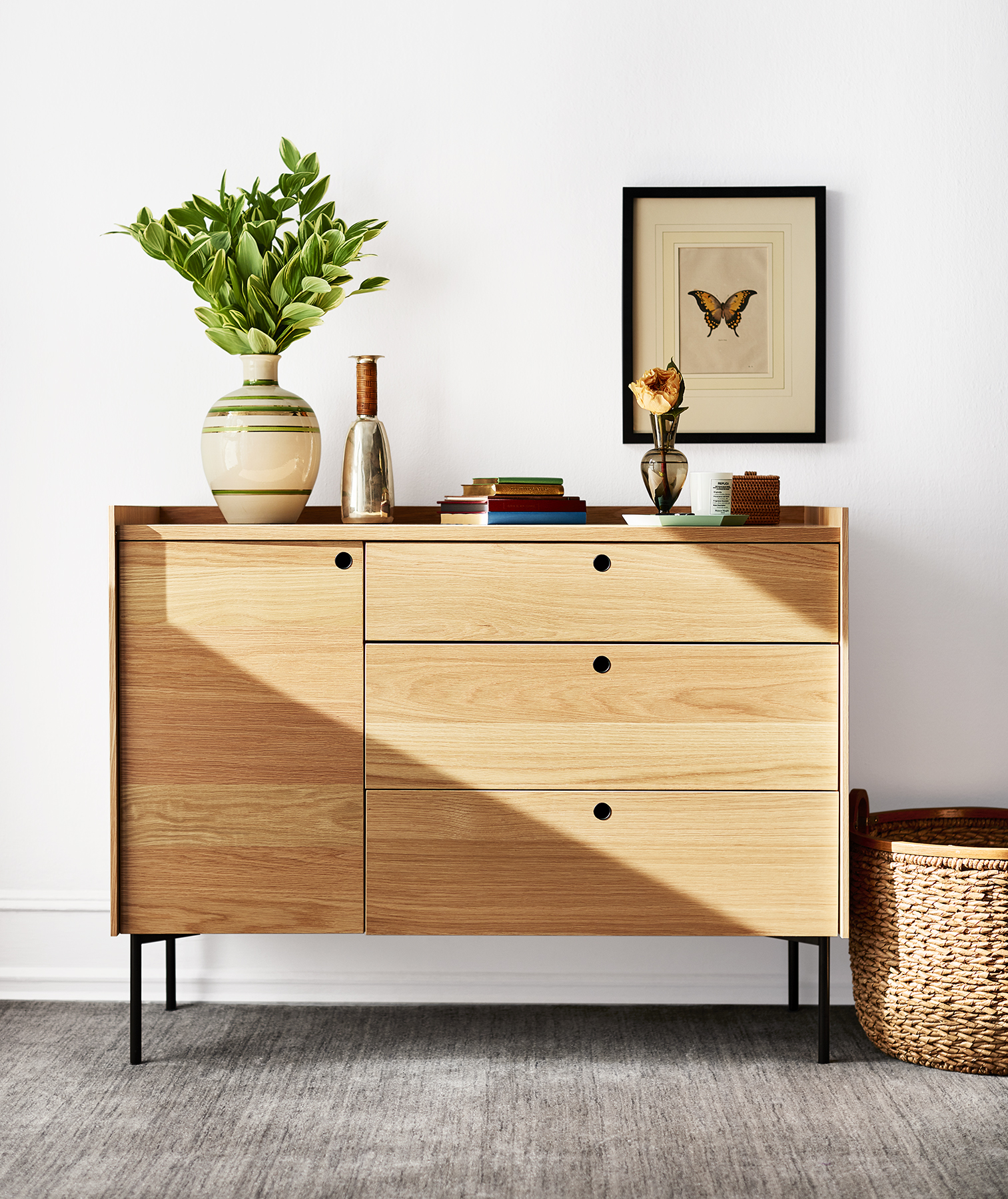 Dresser with plant, art, woven bin