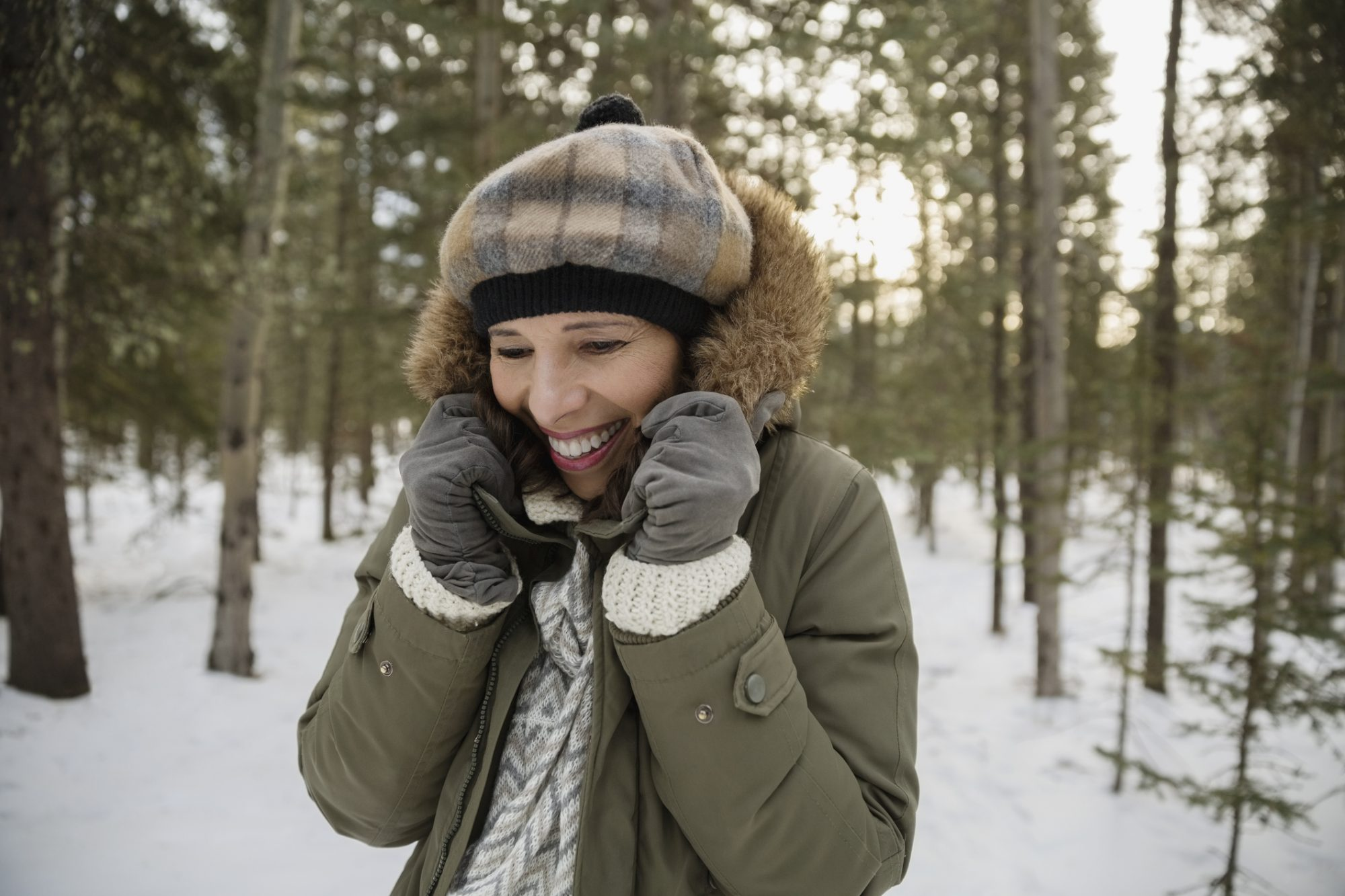 Woman wearing winter clothing outdoors in snow