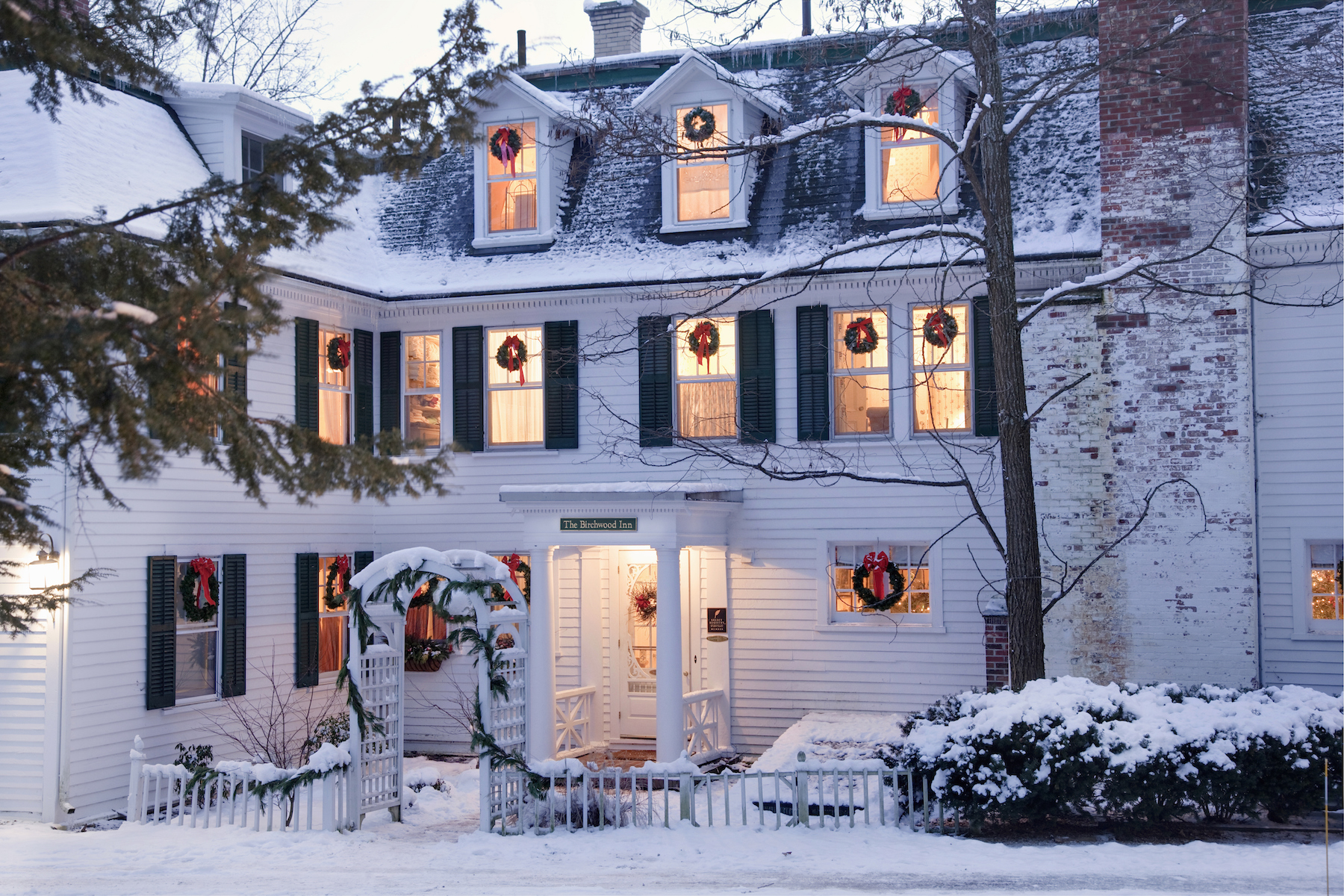 White house with snow, decorated for Christmas