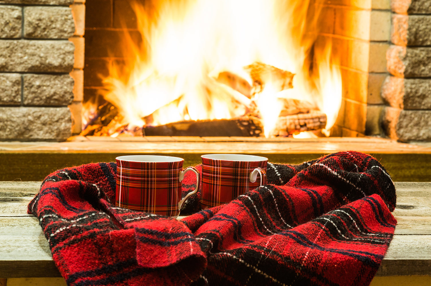 Cozy Fireplace with Mugs
