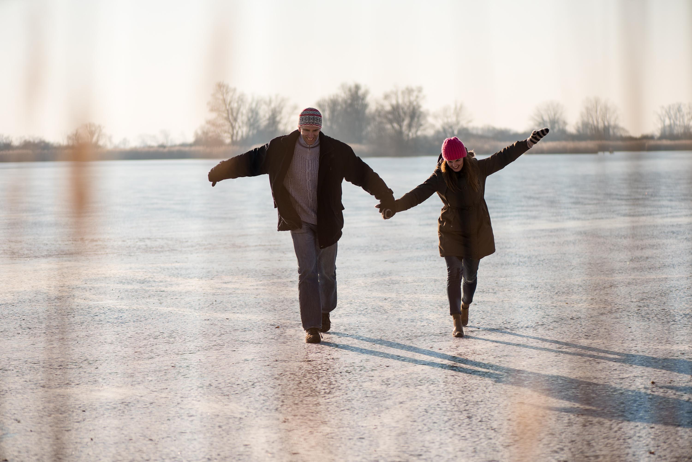 Couple walking on ice