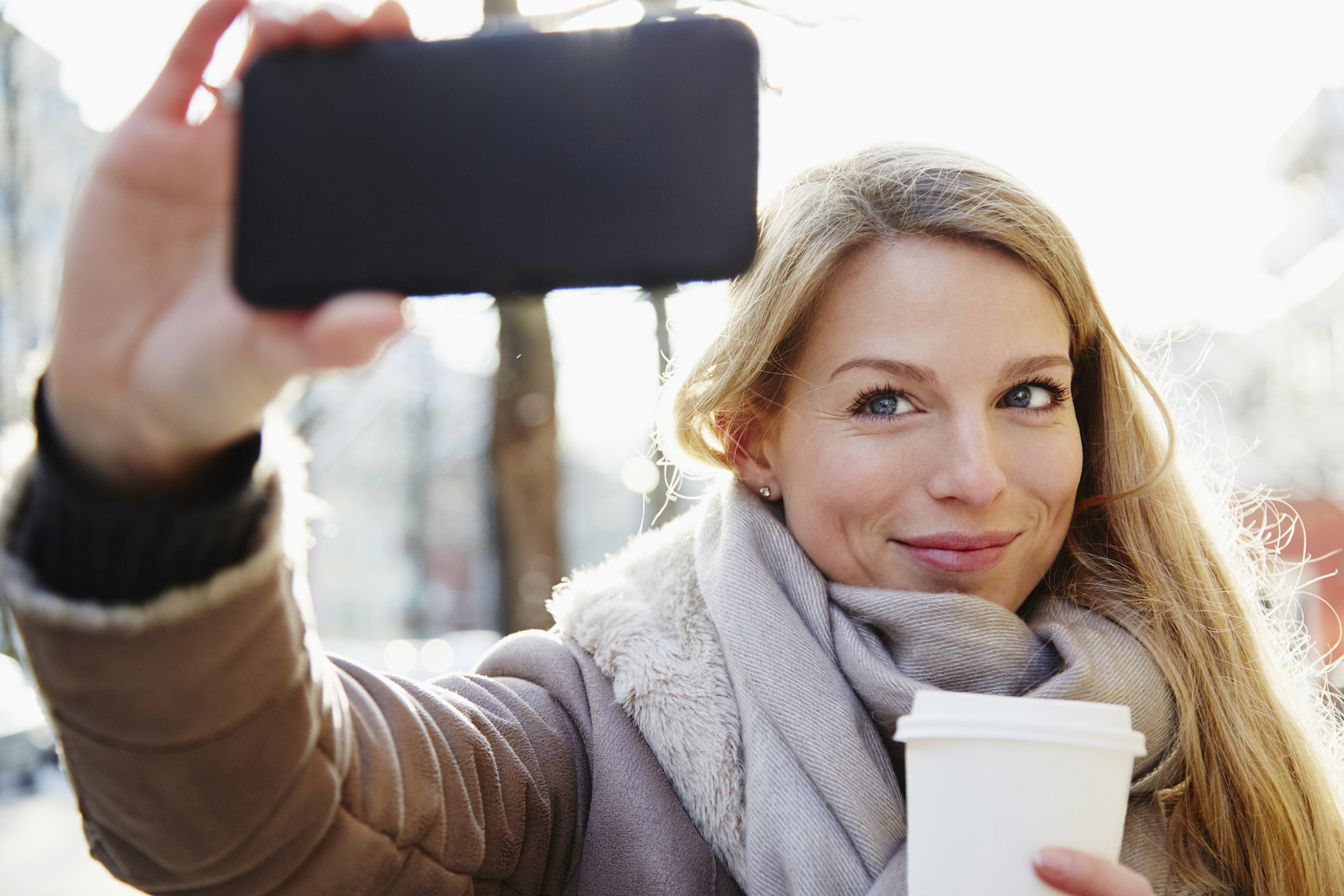 Woman Taking Selfie on smartphone