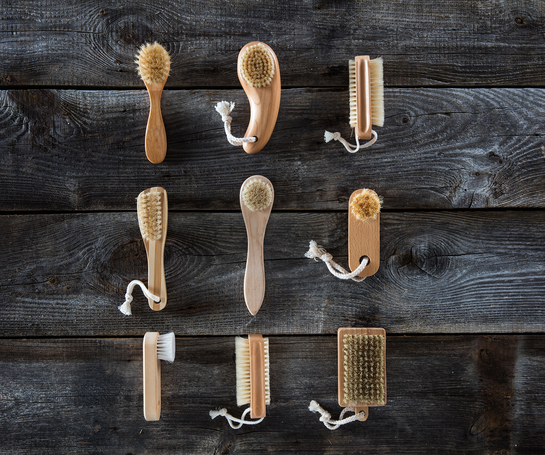 Collection of body brushes on wood surface