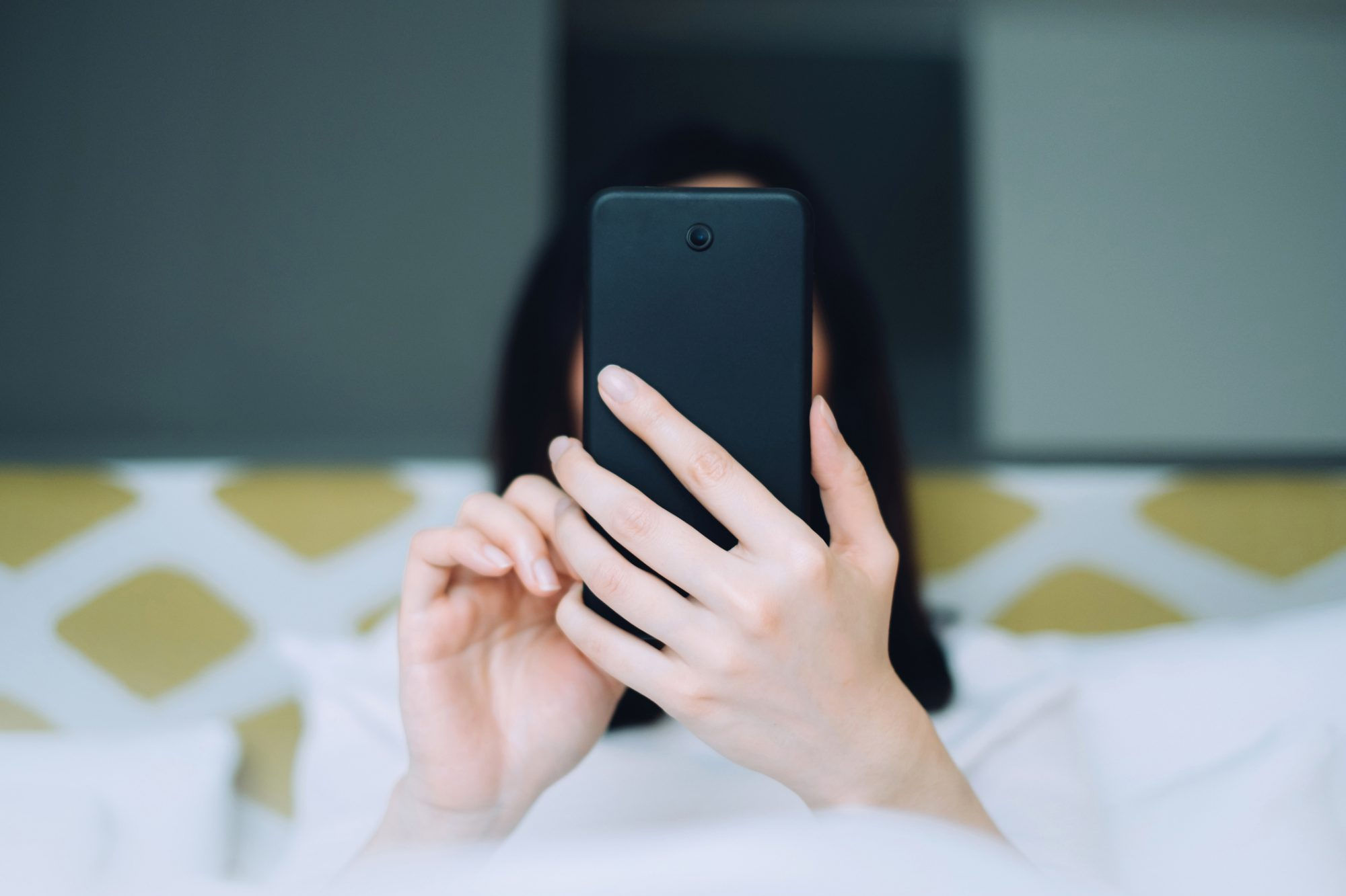 Woman with a smartphone in front of face