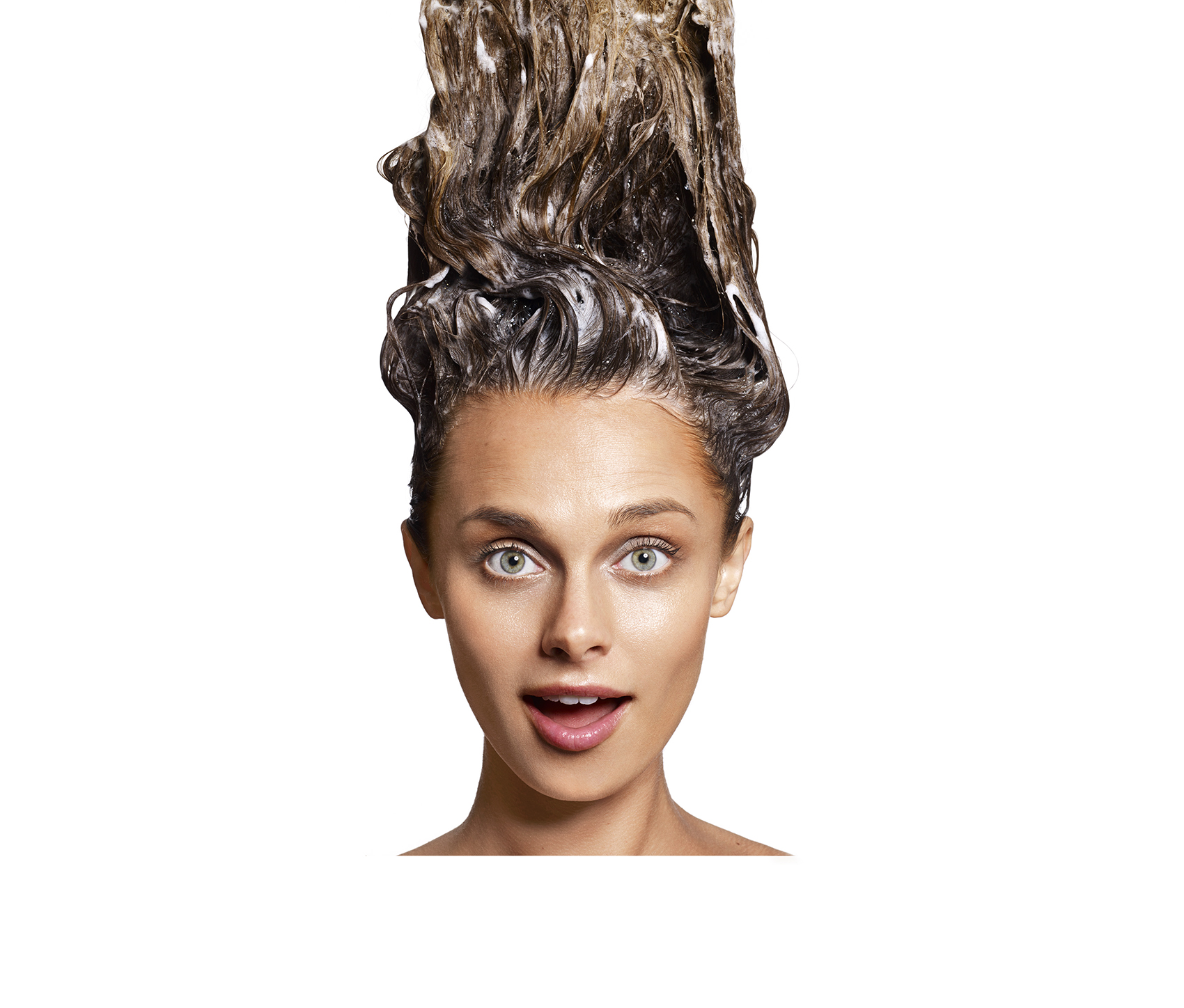 Woman with shampoo in hair