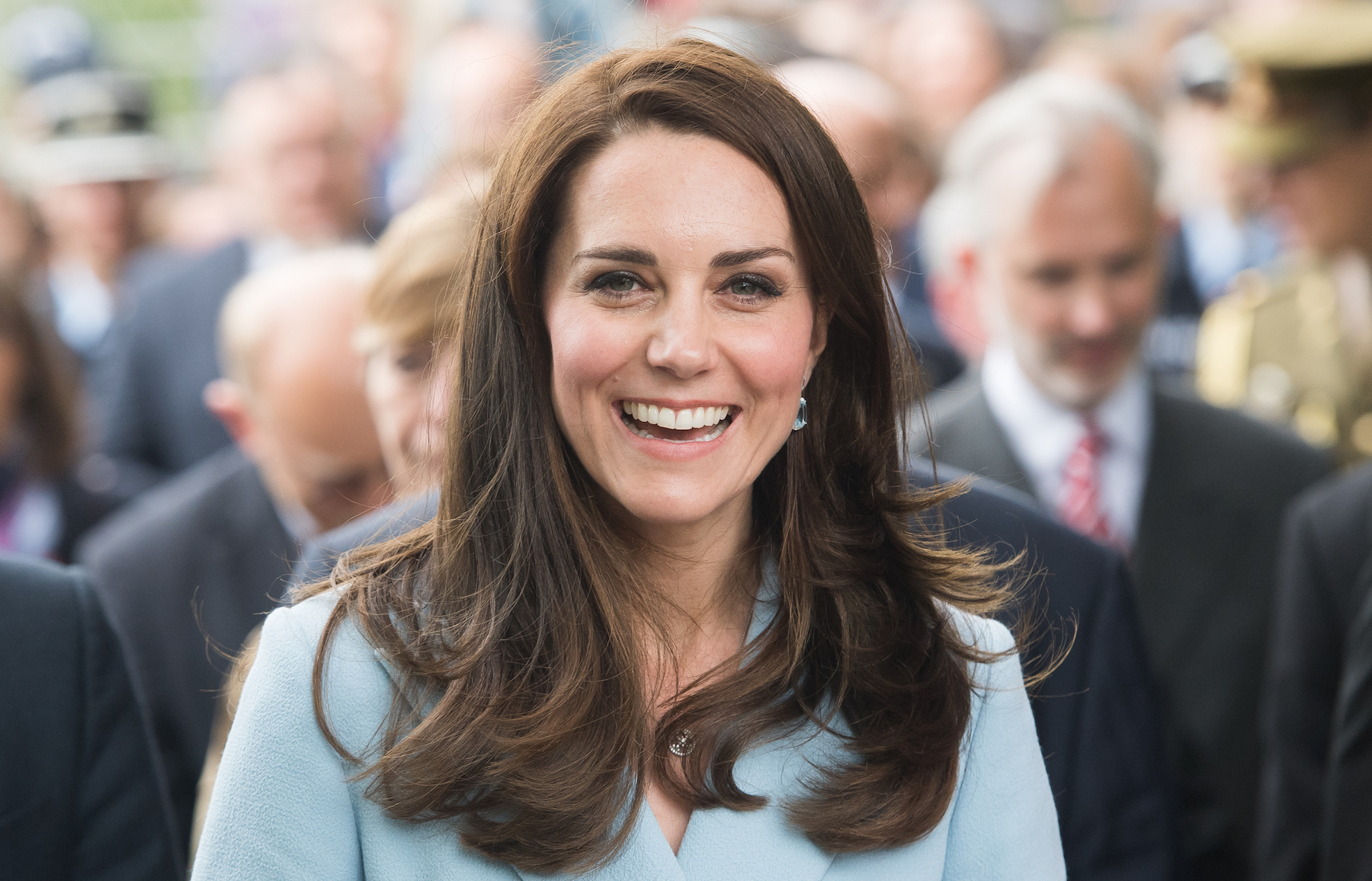 Kate Middleton in light blue coat, smiling