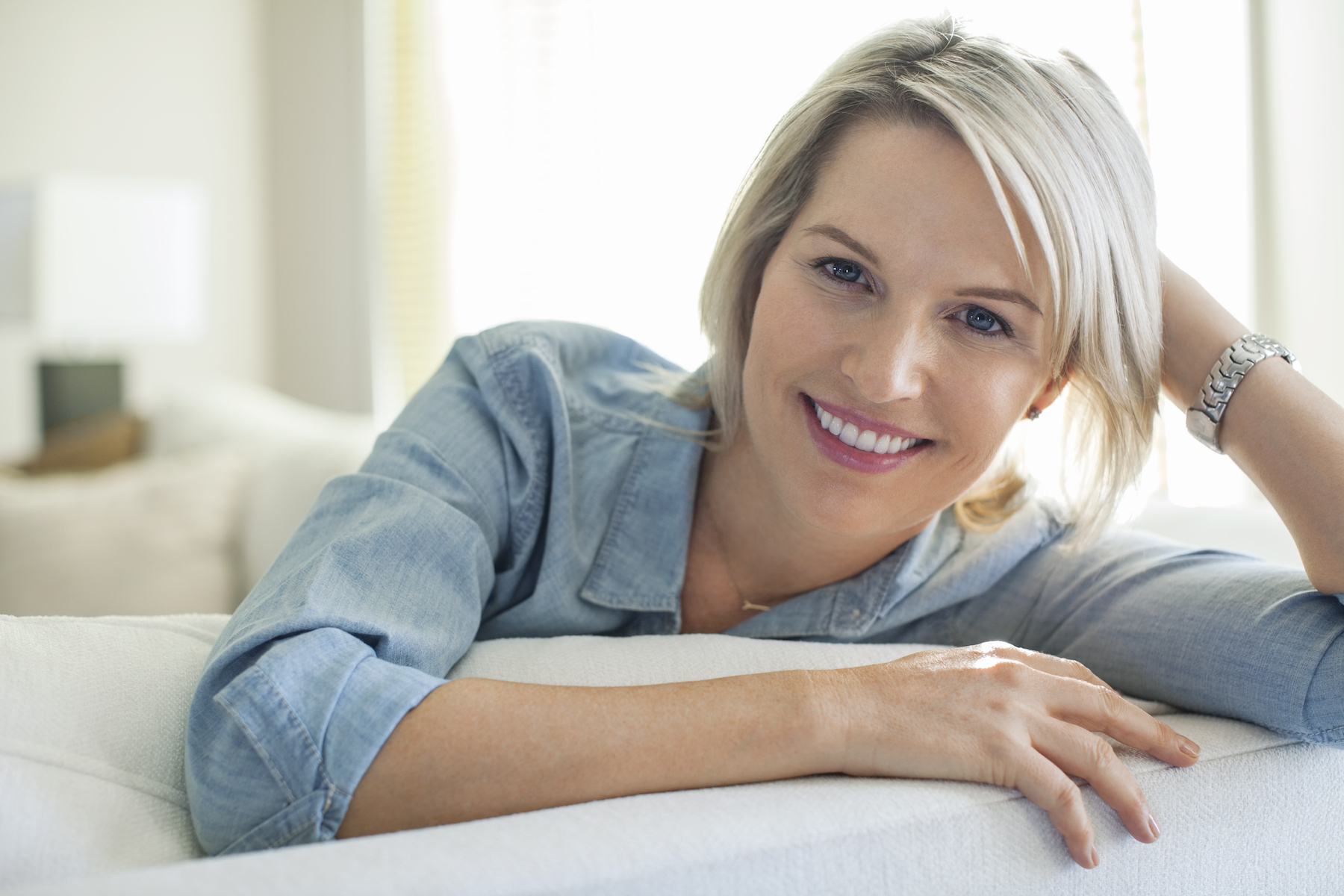 Woman with Ash Blond hair on couch