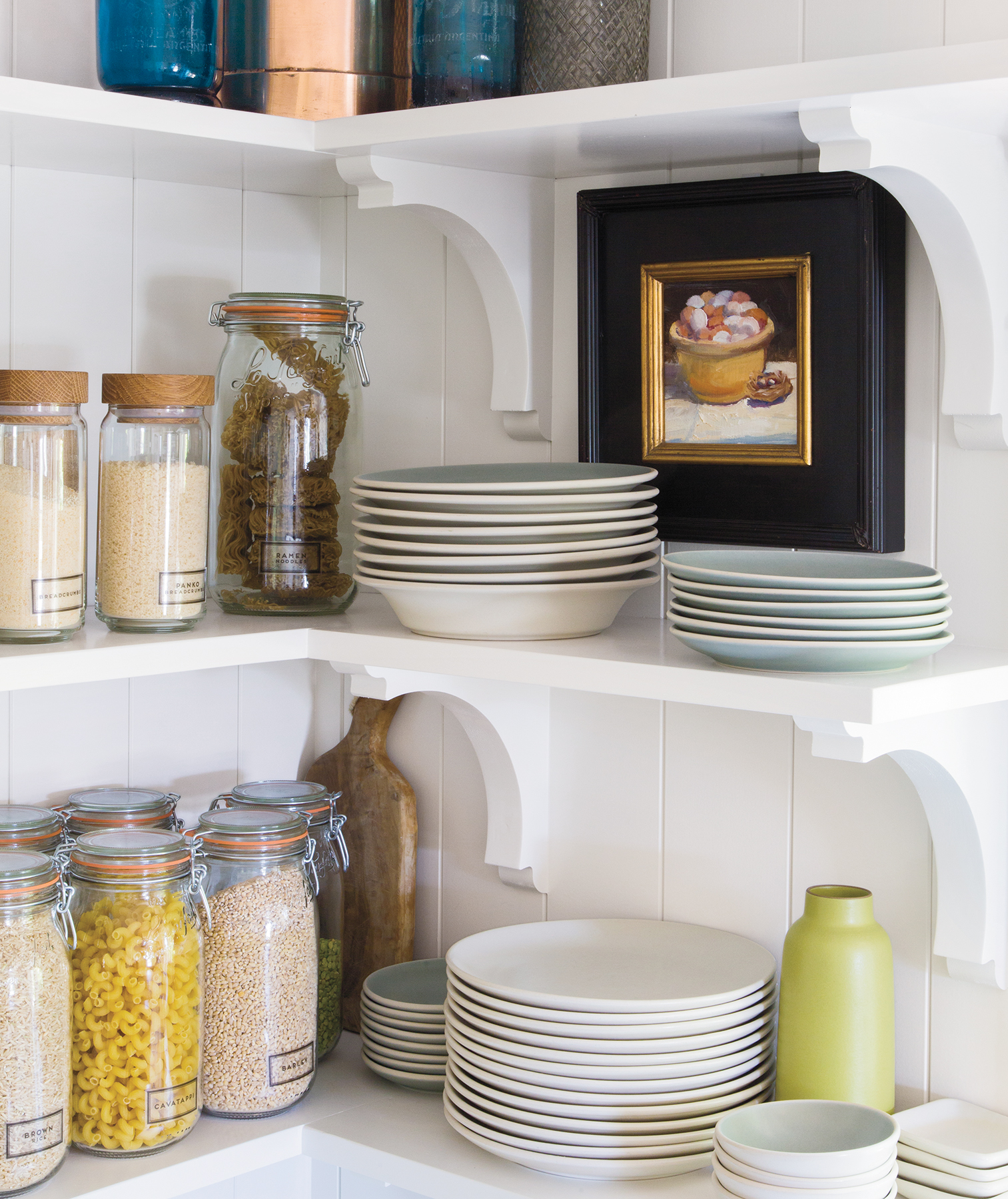 Kitchen open shelving with baking essentials, bowls, plates