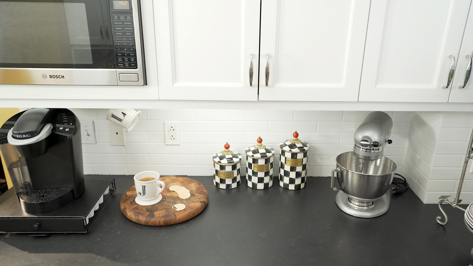 Counter with mixer, coffeemaker, canisters