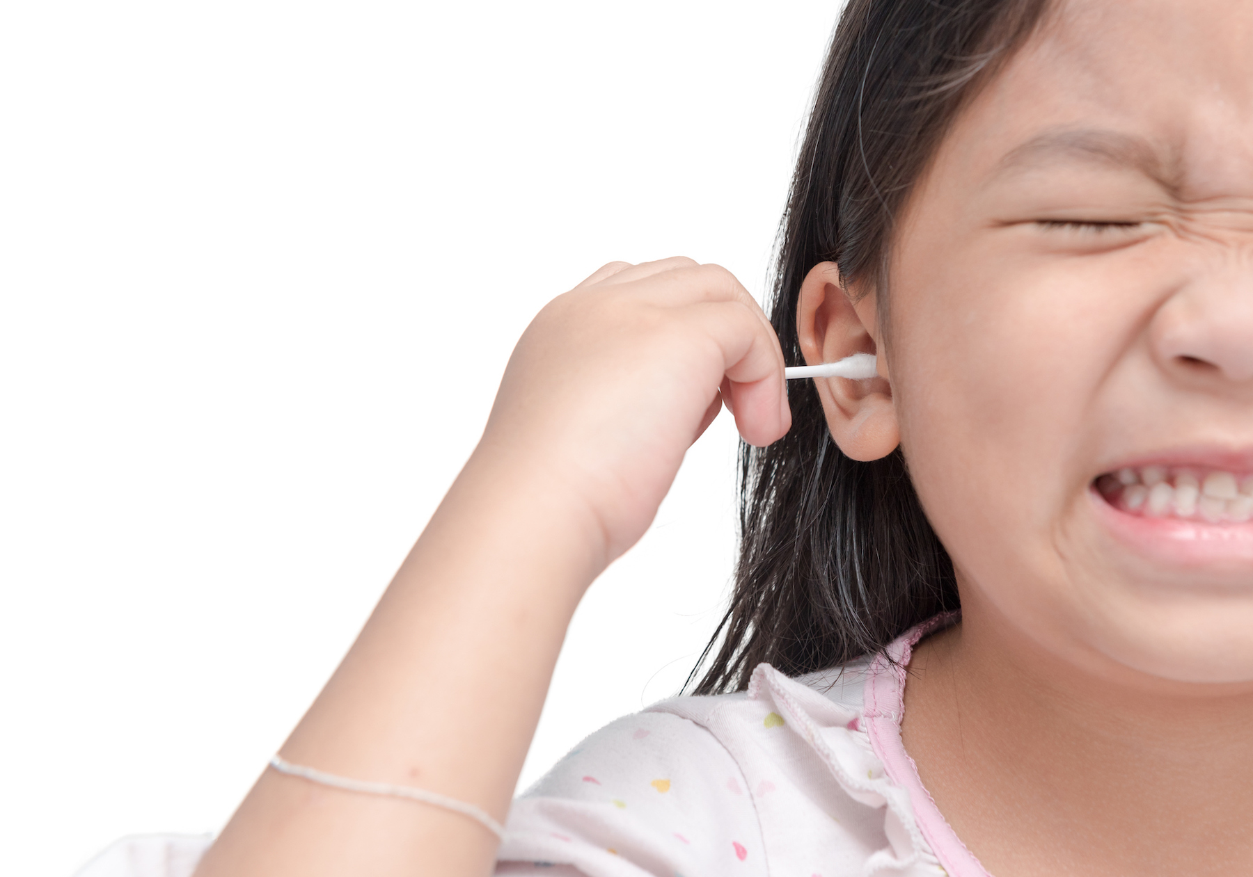 Girl sticking cotton swab in ear
