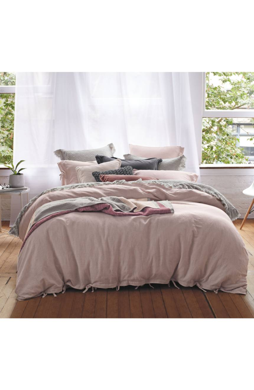 Treasure and Bond Pink Bedding on bed