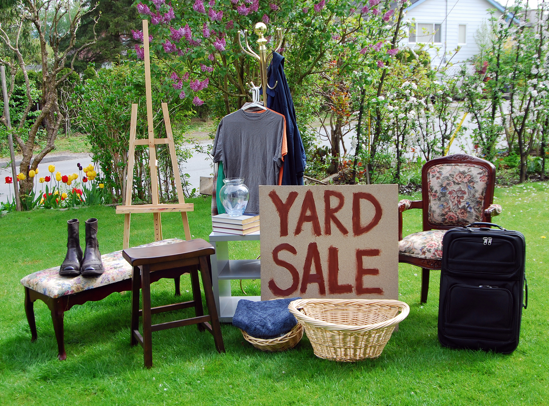 Yard sale with items for sale, sign
