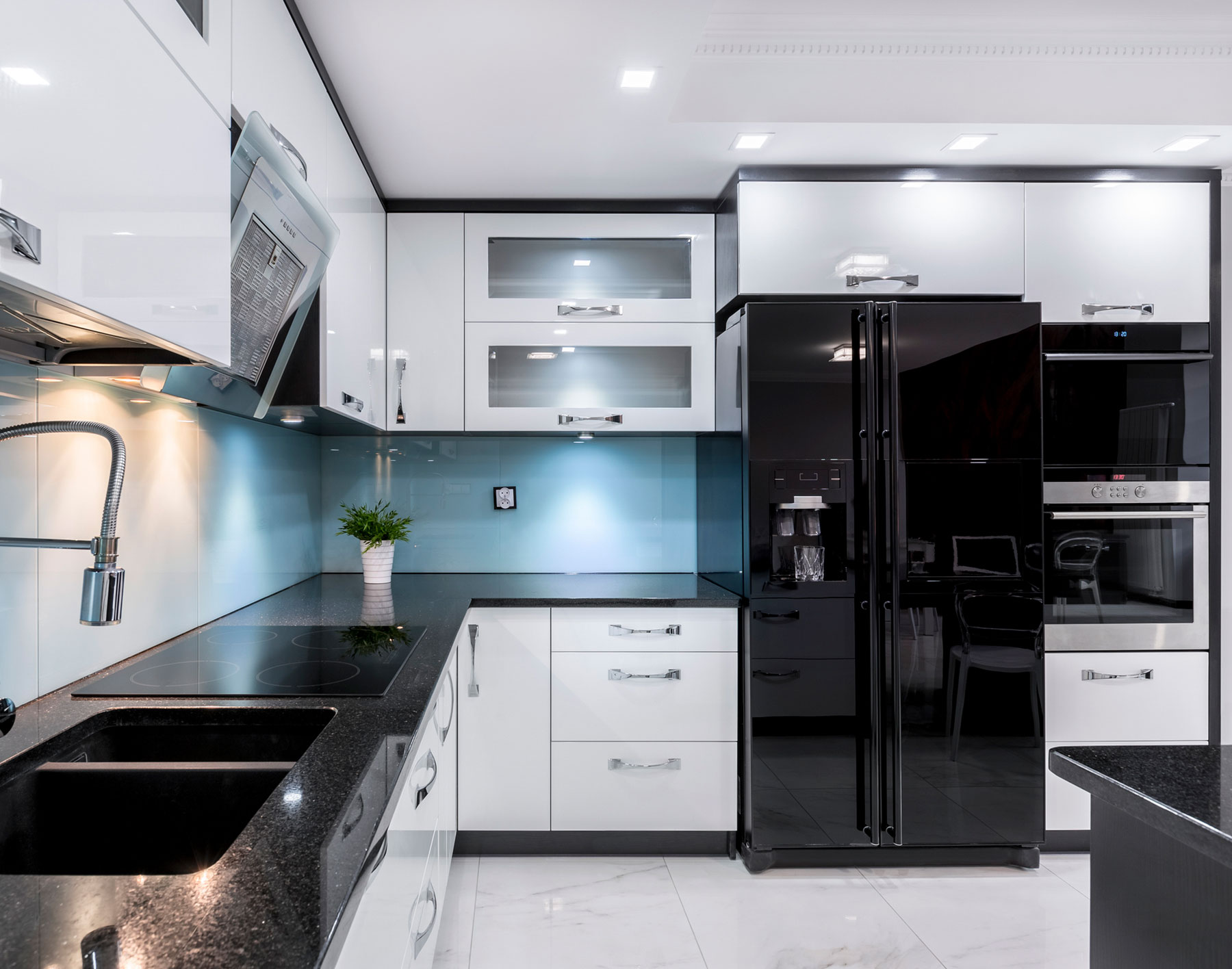 Kitchen with black stainless steel appliances