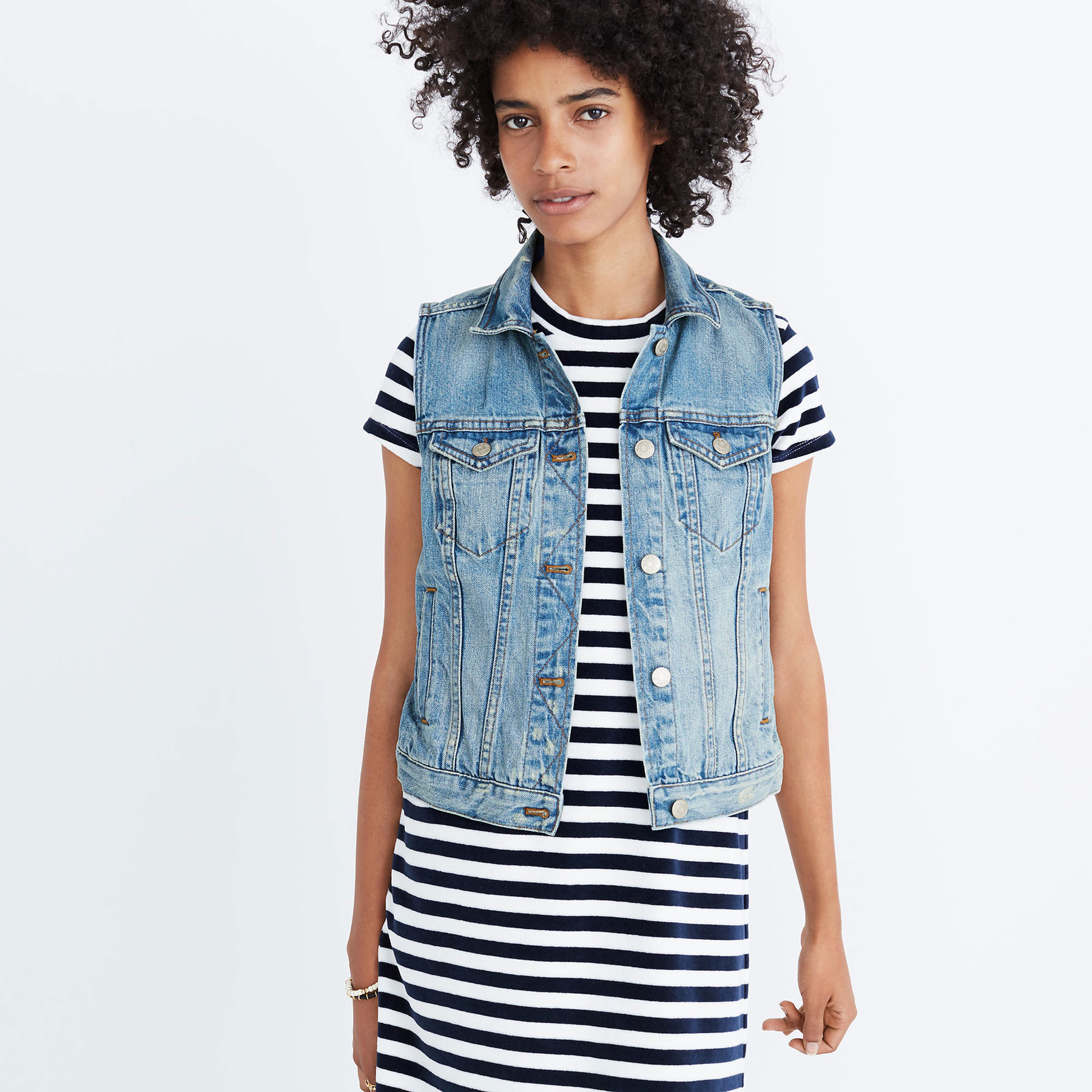 Woman wearing a denim vest from Madewell