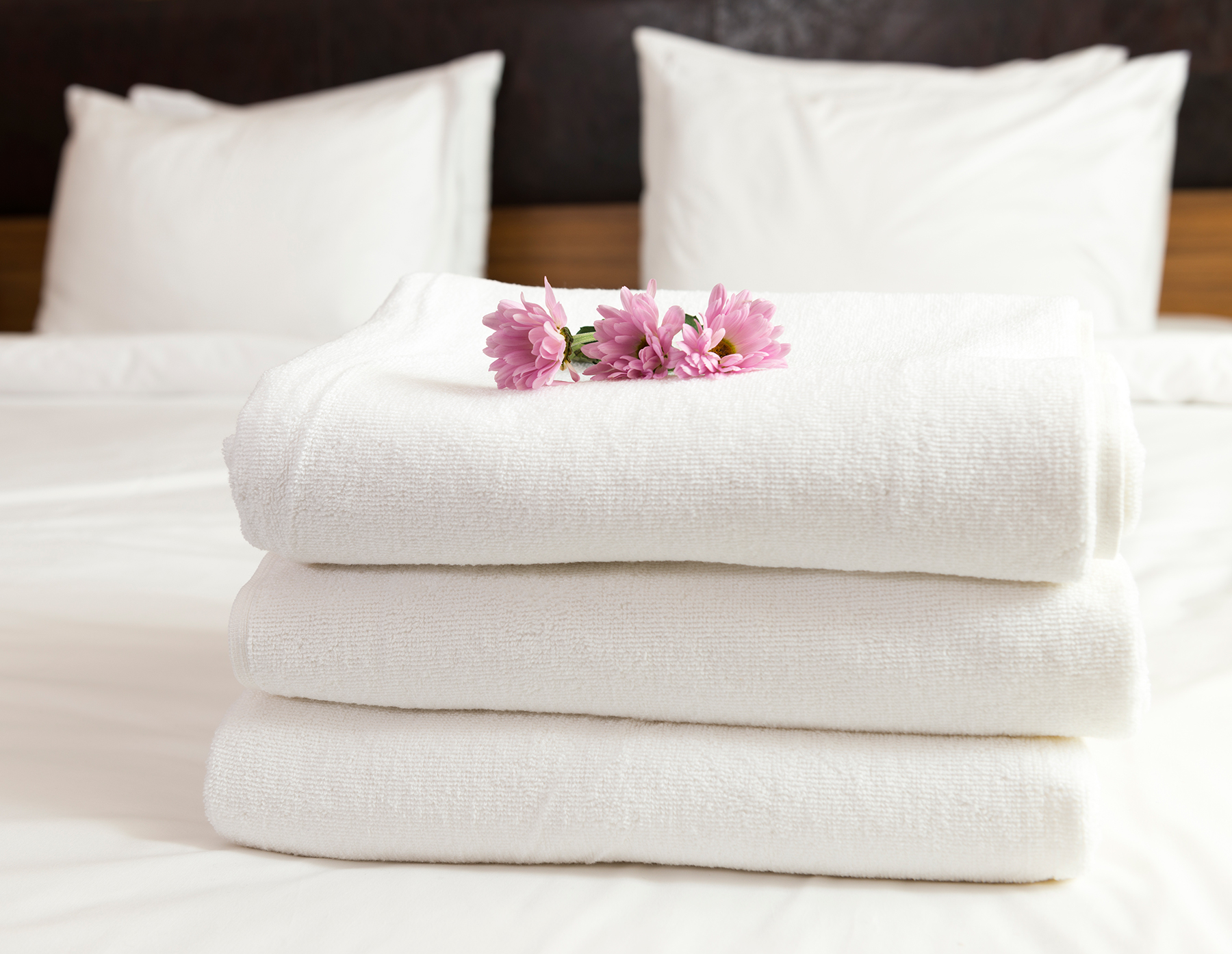Hotel bed and towels