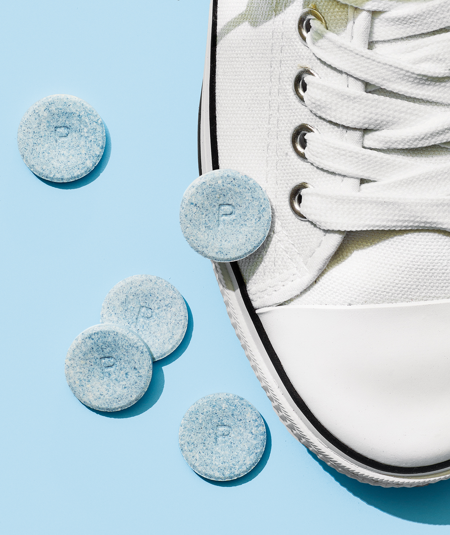 Denture tabs and white sneakers