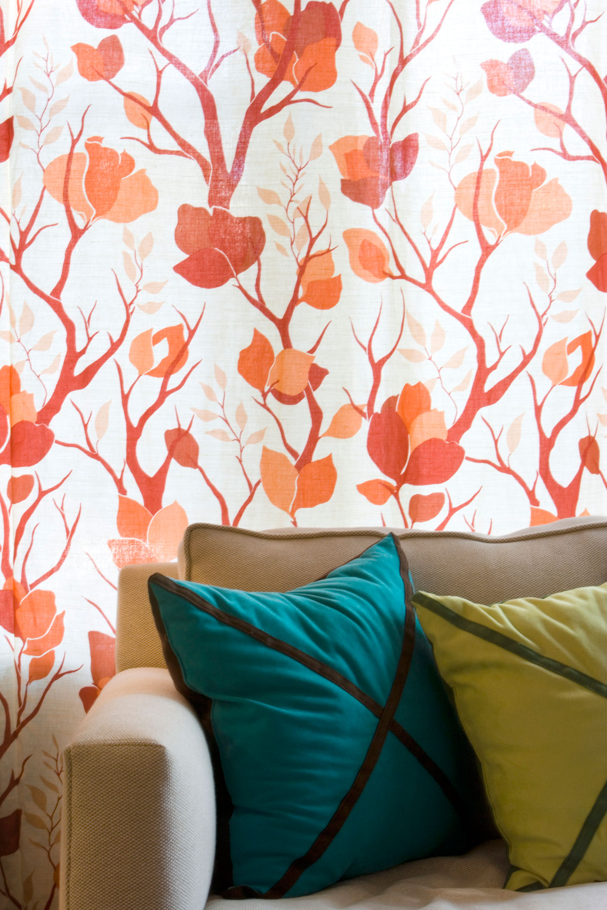 Living room with orange tree patterned wallpaper