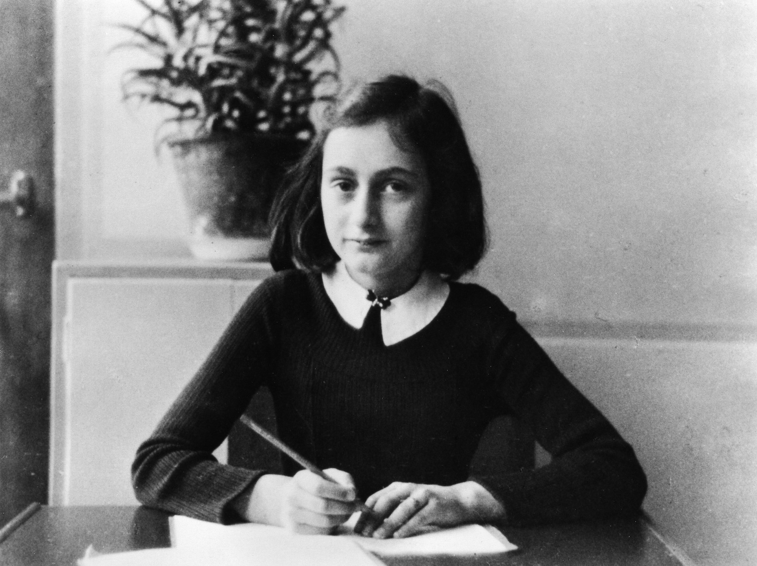 Anne Frank Writing the Diary of a Young Girl