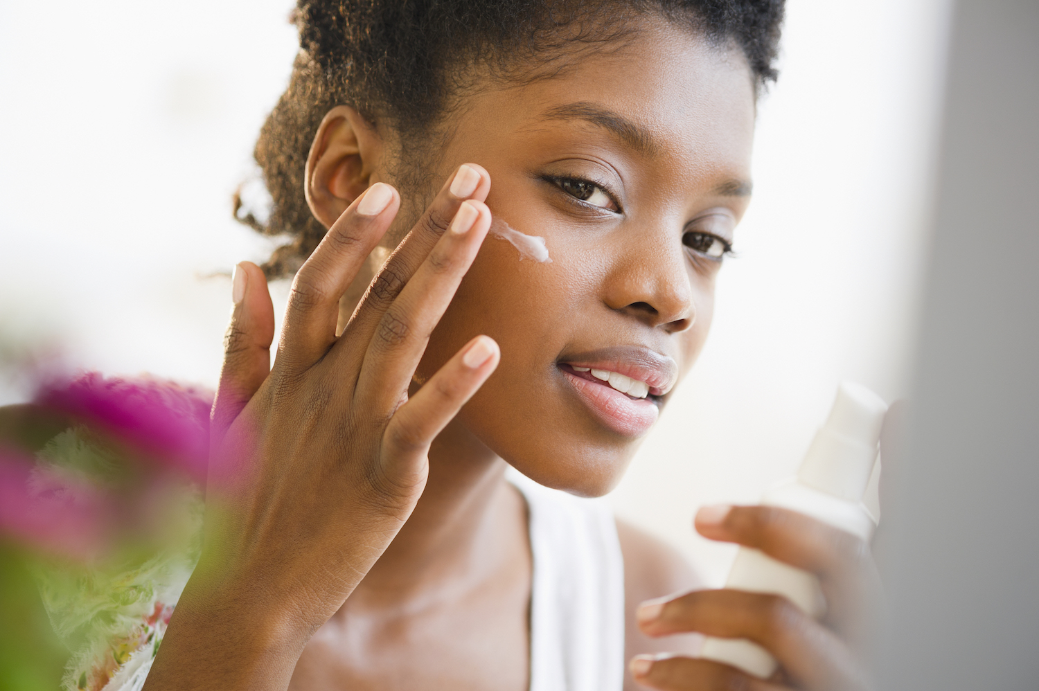 Woman Putting on a Skin-Care Treatment