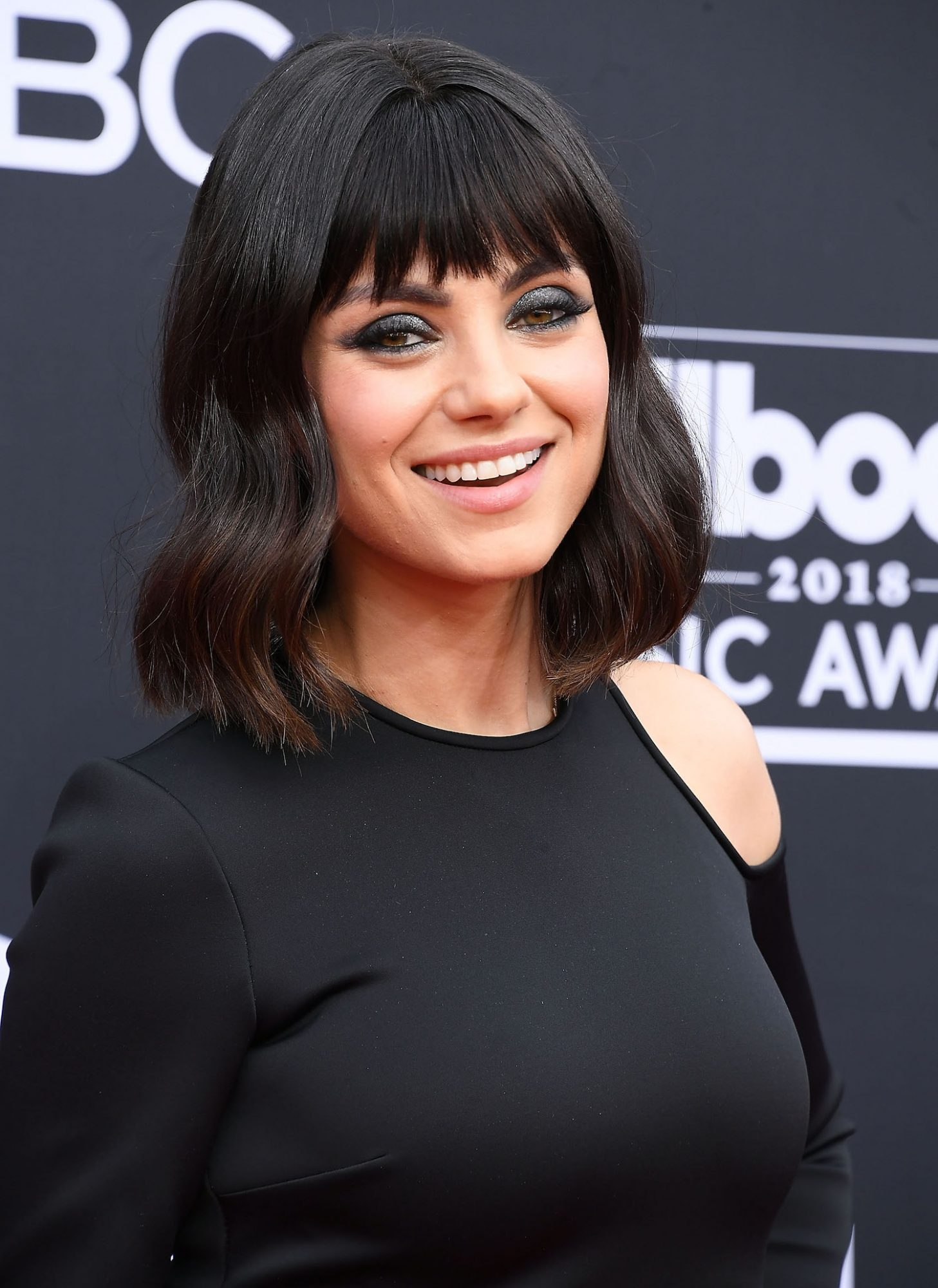 Mila Kunis With Short Hair and Bangs Trendy Hairstyle