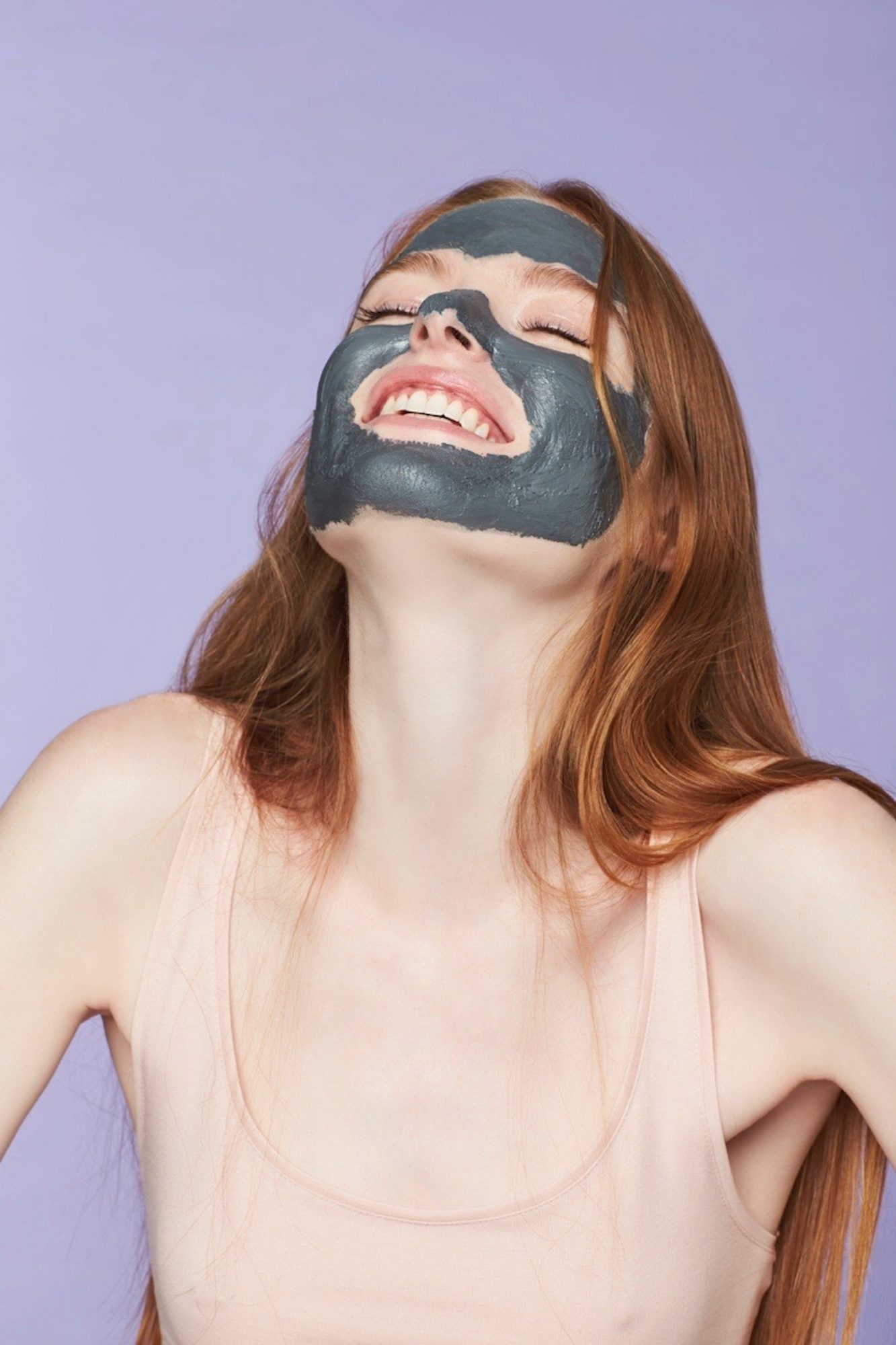 A Woman Uses a Charcoal Face Mask in Her Skin-Care Routine