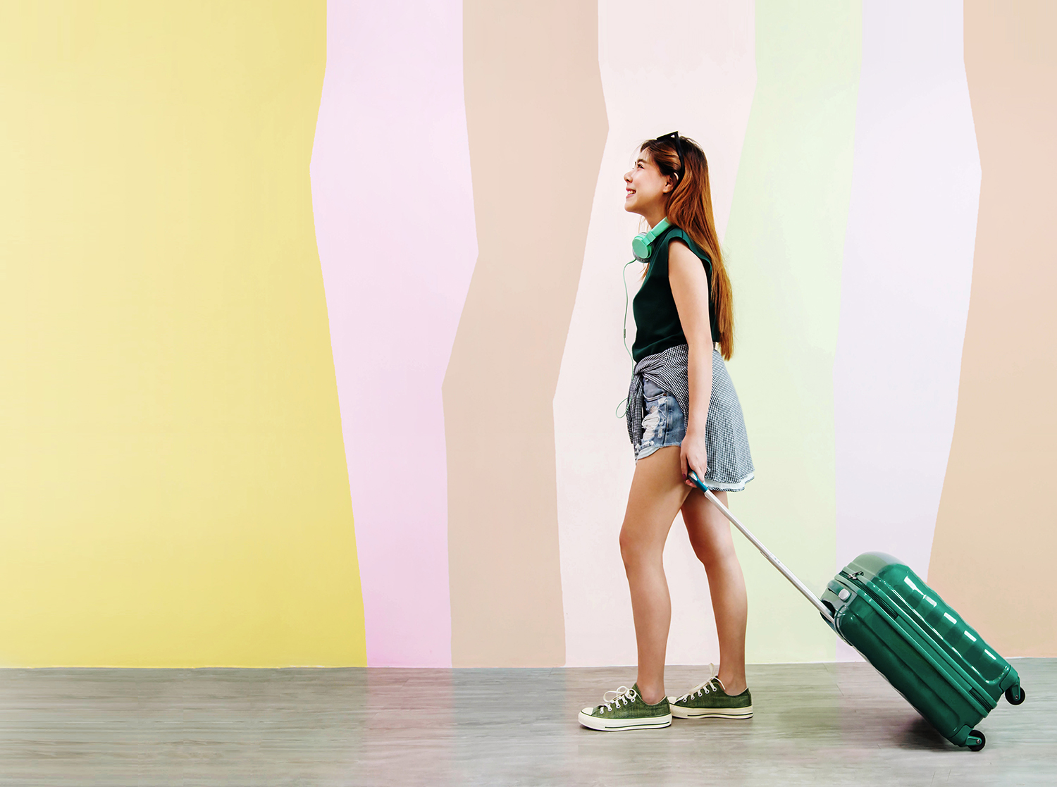 Woman By Rainbow Wall With Suitcase