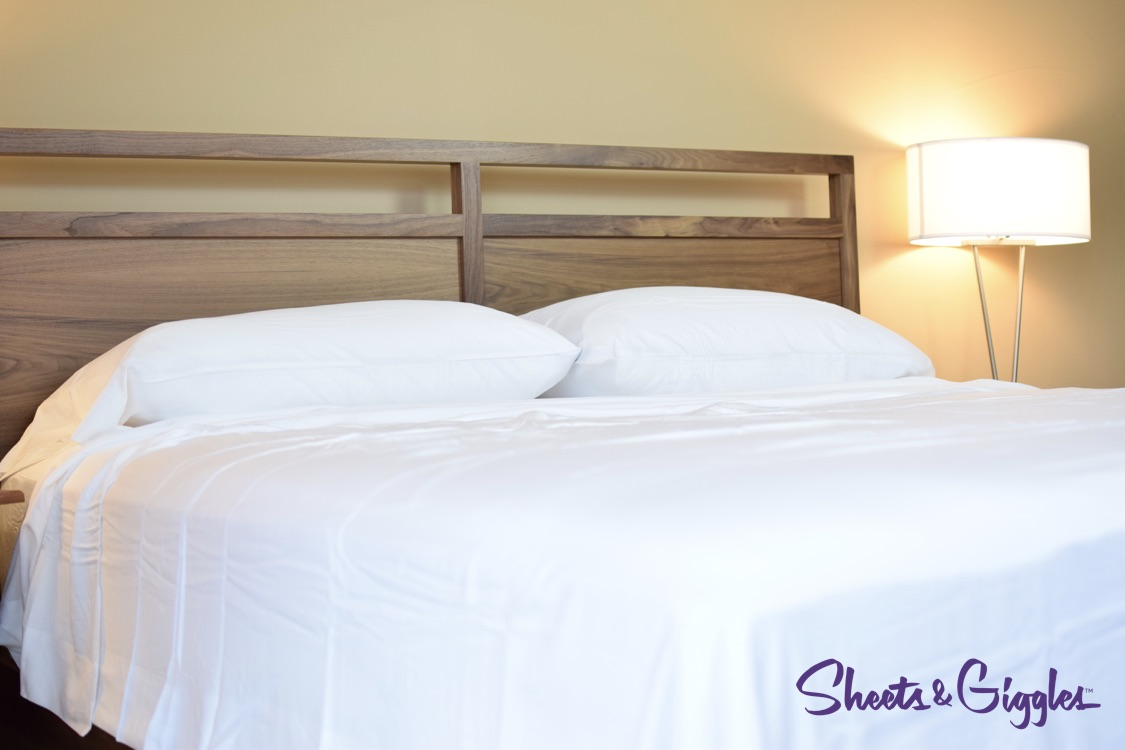 Sheet Giggles on Bed