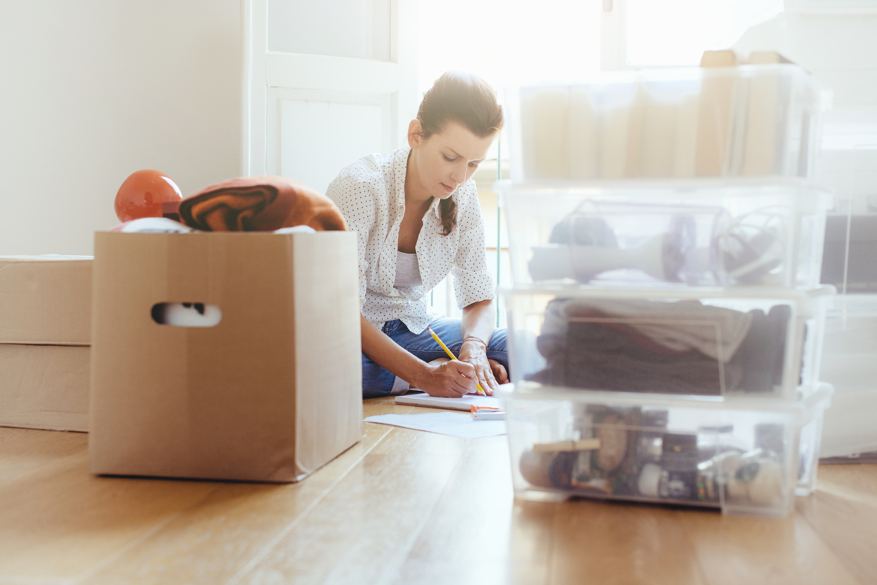Emotionally Difficult Clutter, woman packing up belongings