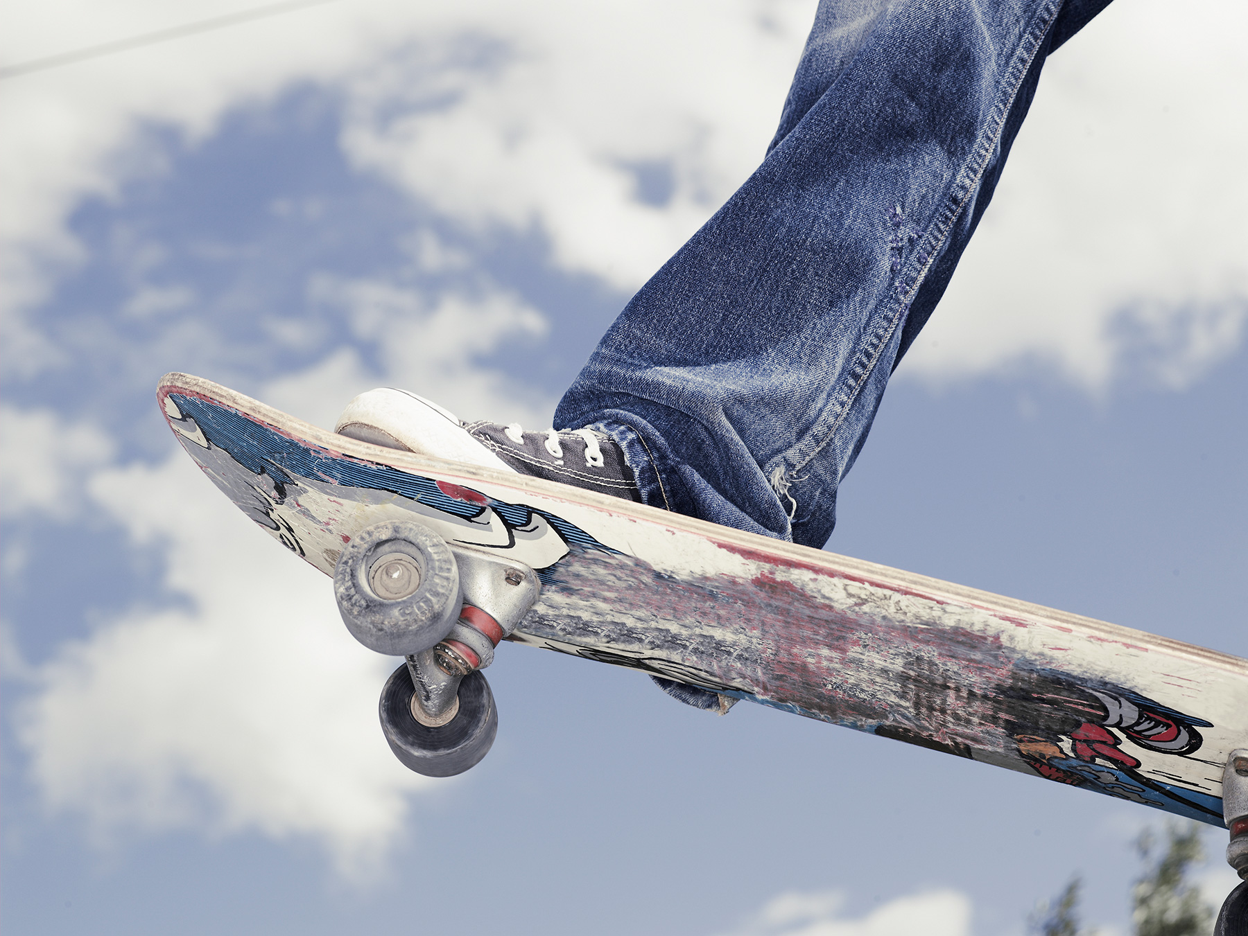 Closeup of sneaker on skateboard