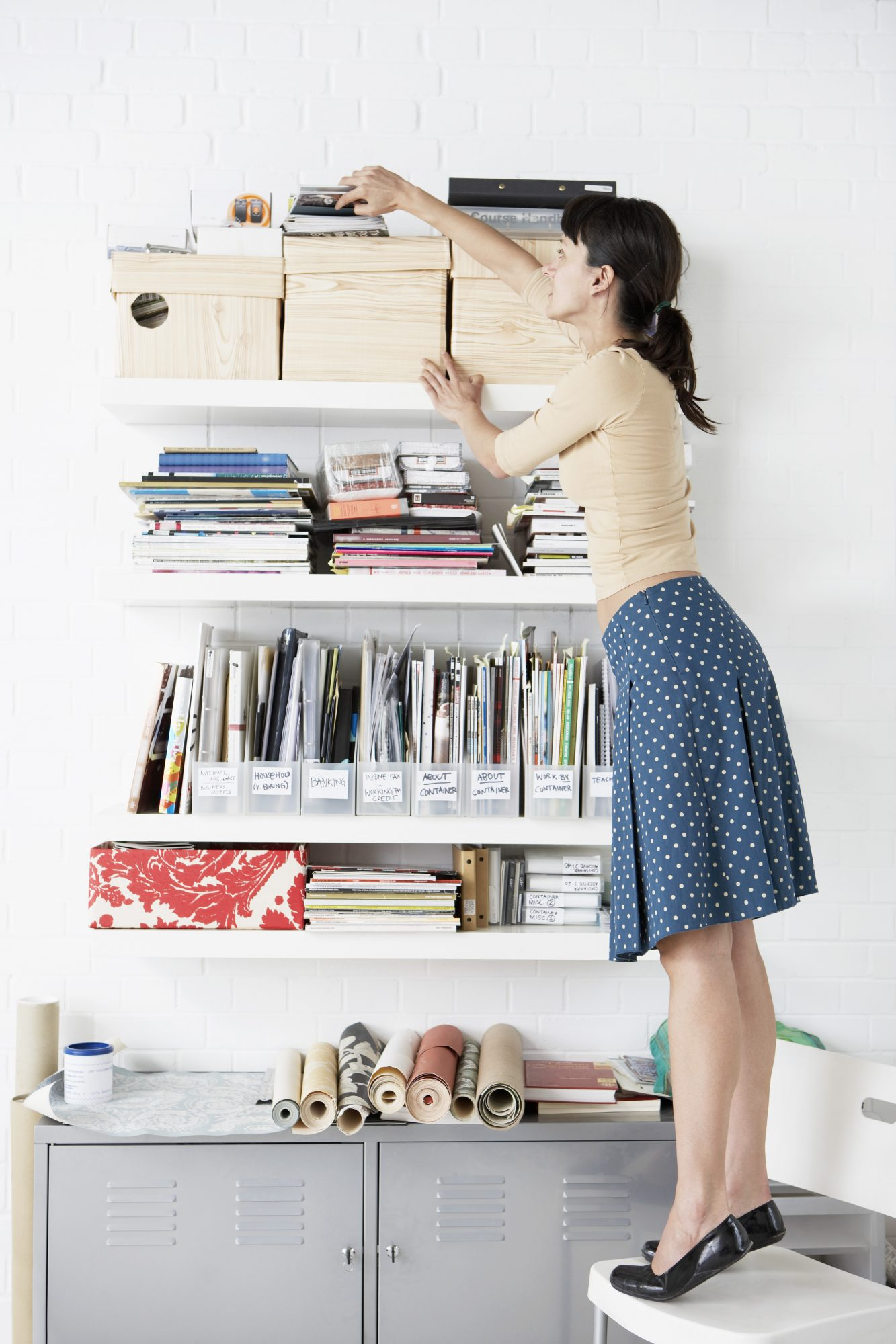 Woman Organizing Shelf