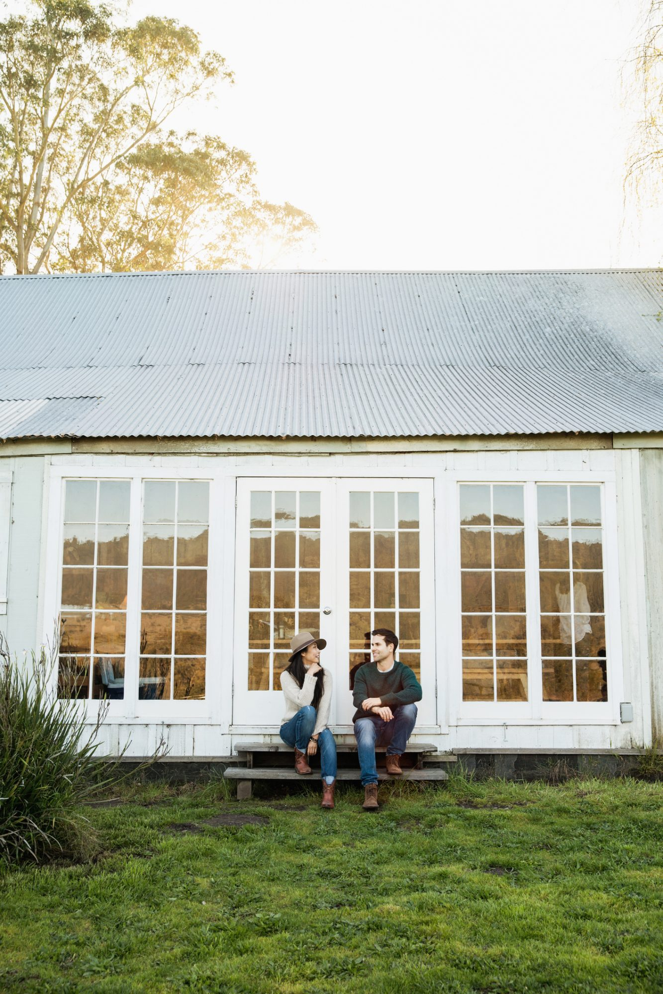 Couple sitting on the porch of their country house