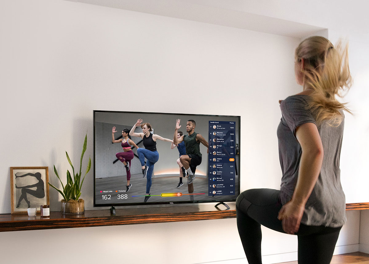 Woman working out with ClassPass Live