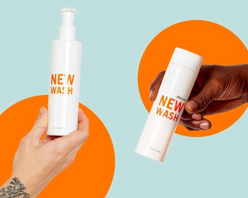 New Wash Shampoo bottles held by two people