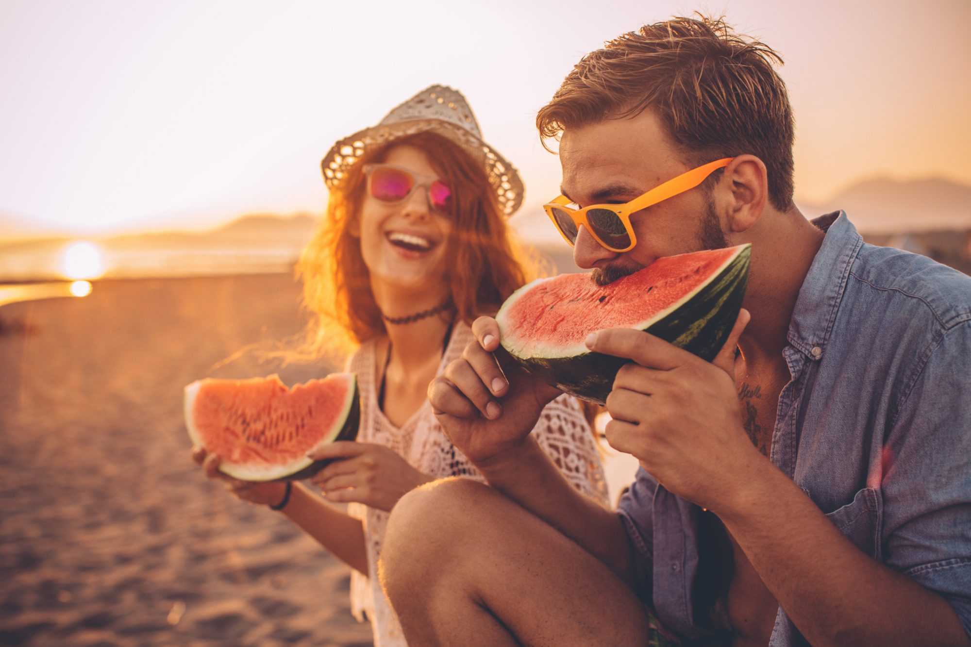 Couple eating watermelon, but is it better to eat candy when a sugar craving hits?