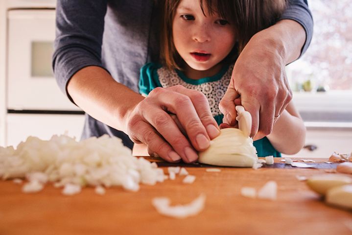 A mom cooking with kids