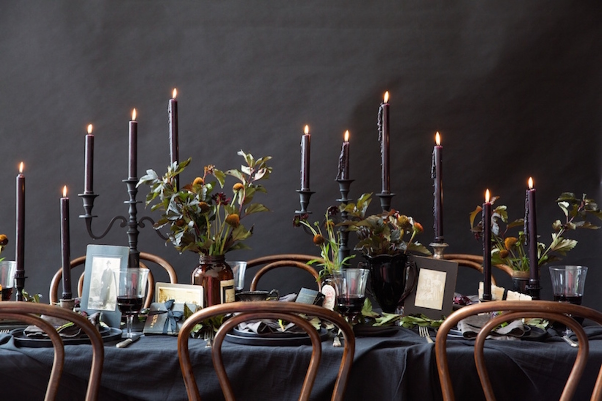 Halloween dinner party with black candles and flowers