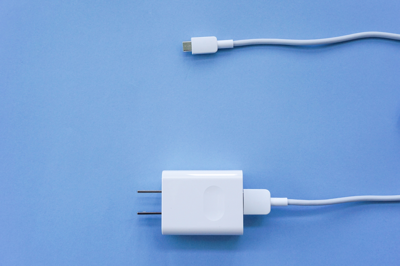 white phone charger on blue background