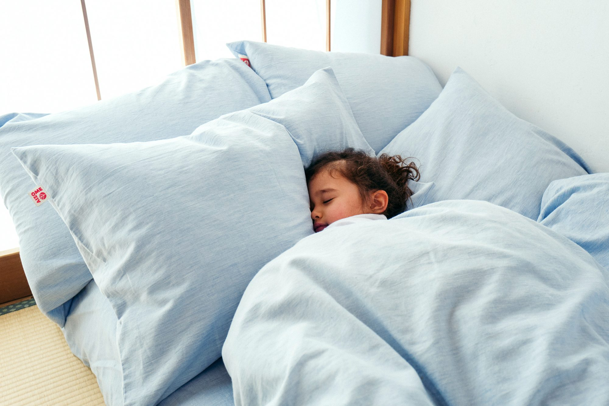 Girl sleeping in Aizome Indigo Dyed Hypoallergenic Bedding