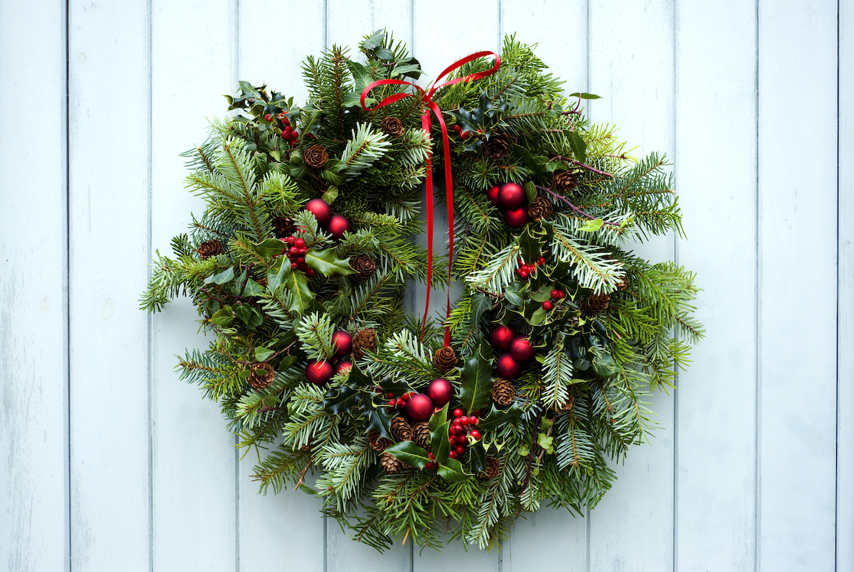 green holiday wreath with red bow