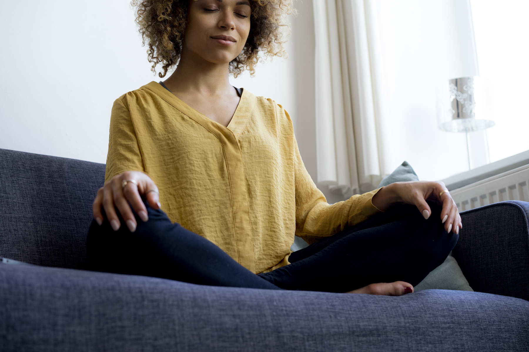 Breathing Exercises for Anxiety, Woman Meditating on couch