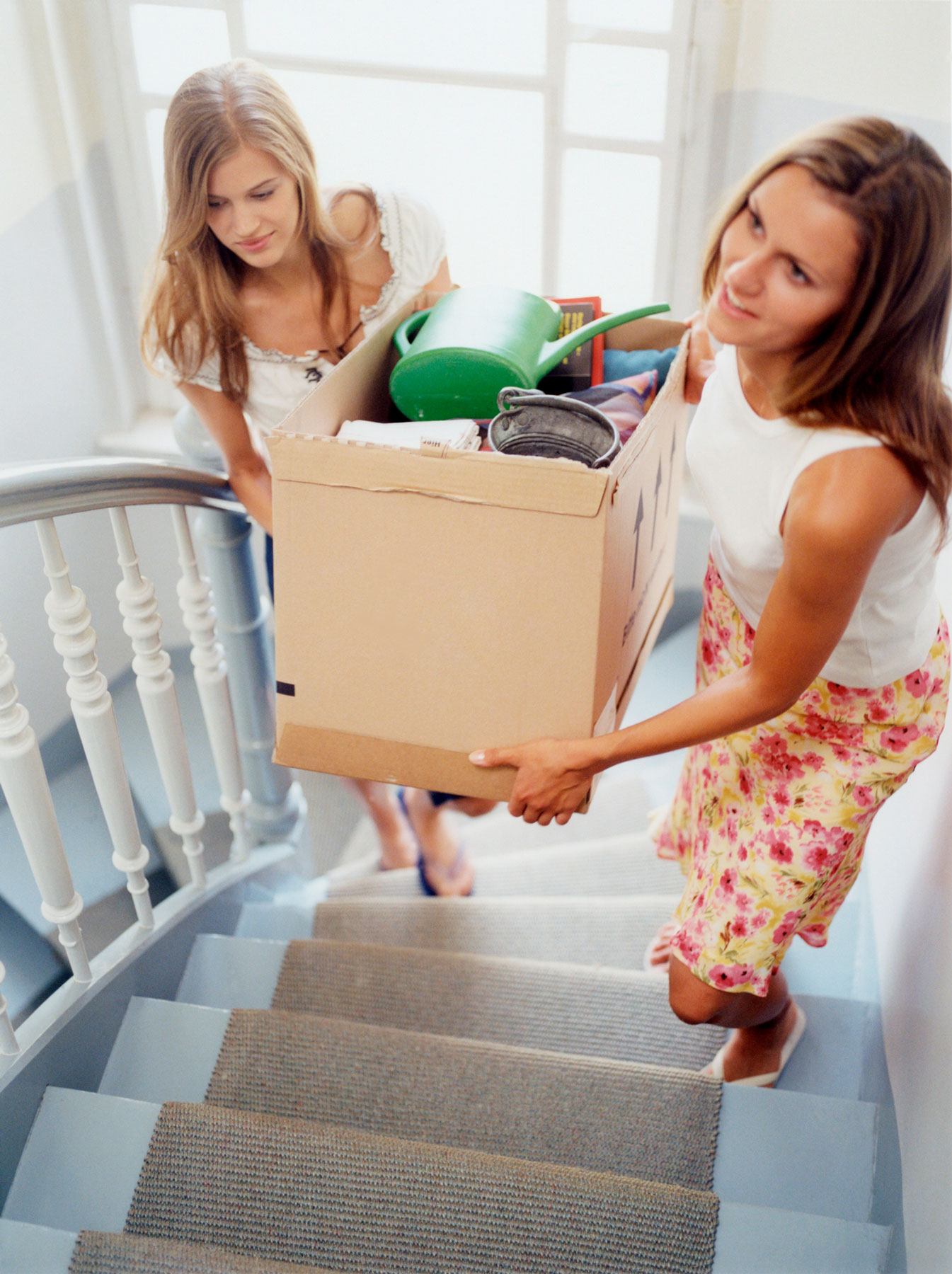 Decluttering Tips Buddy System - two women decluttering together