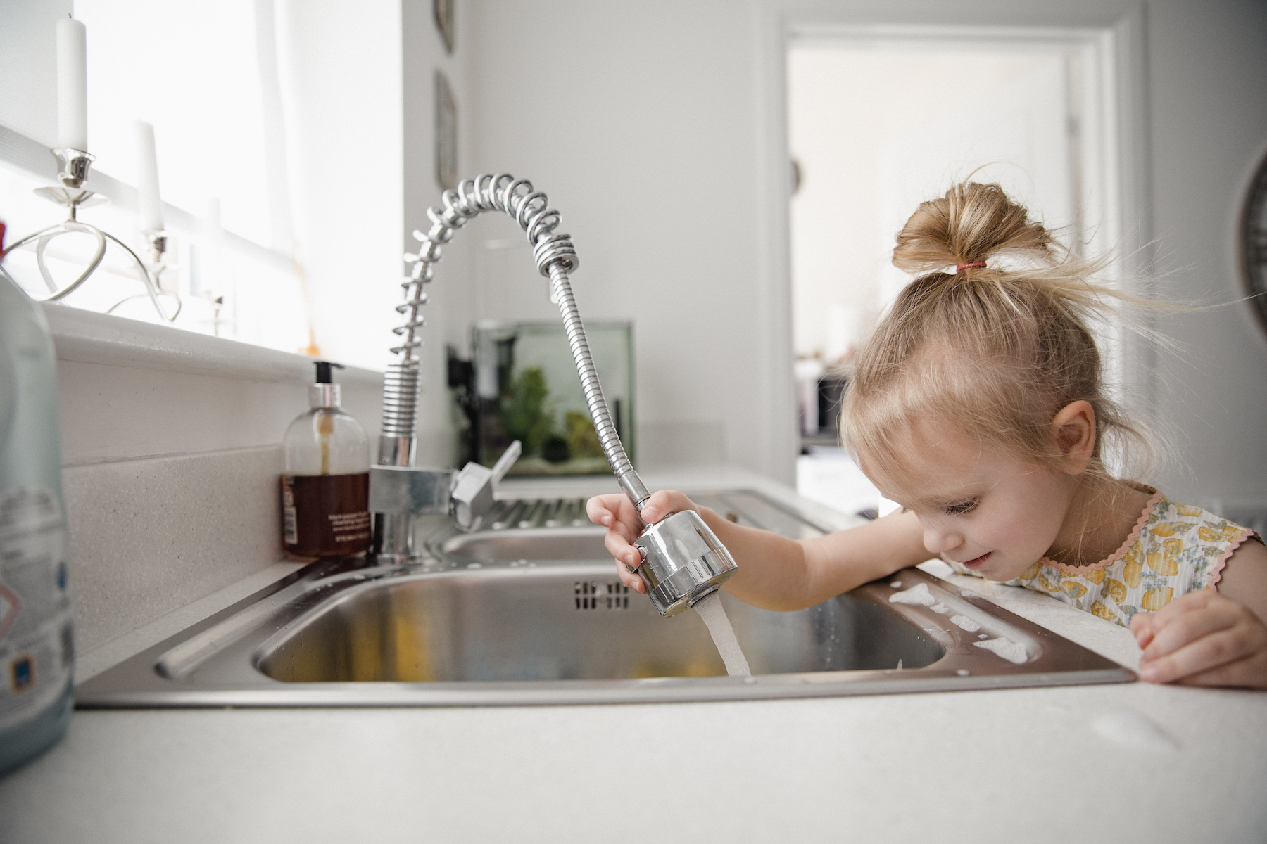 How to Clean Stainless Steel Sink, little girl at kitchen sink