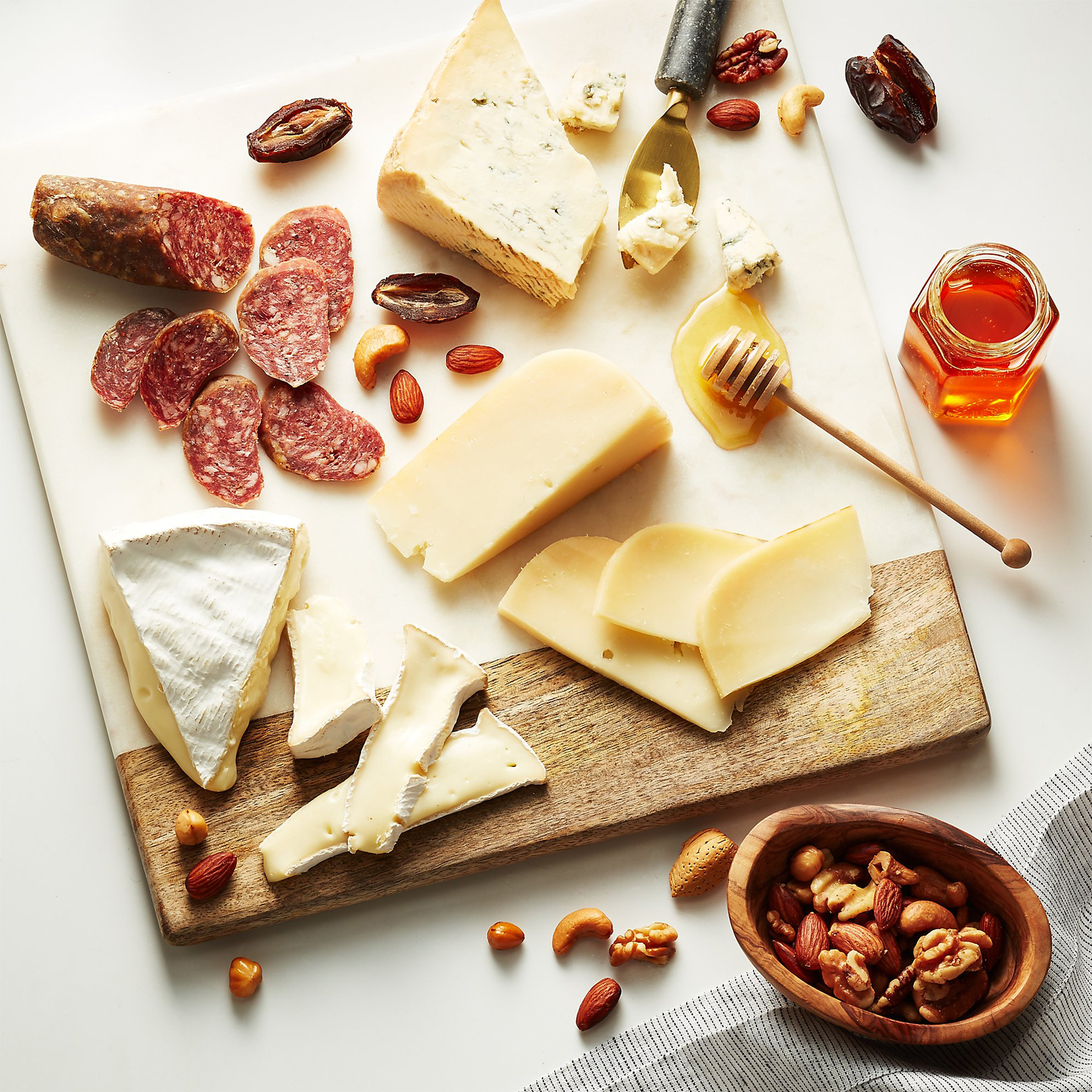 Crate and Barrel cheese and charcuterie board collections - the Party Starter
