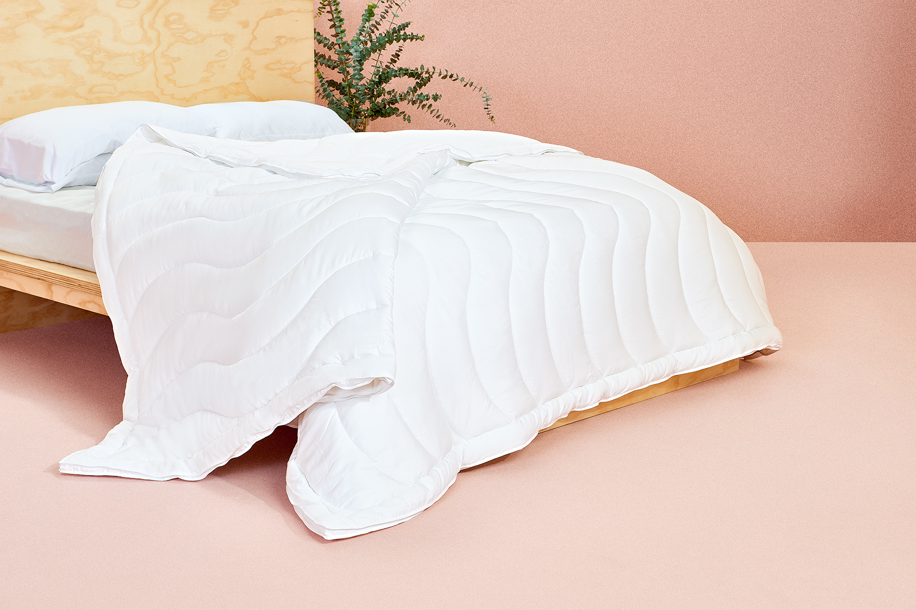This Cult-Favorite Bedding Brand Released a Eucalyptus Cooling Comforter That Will Help You Sleep Better