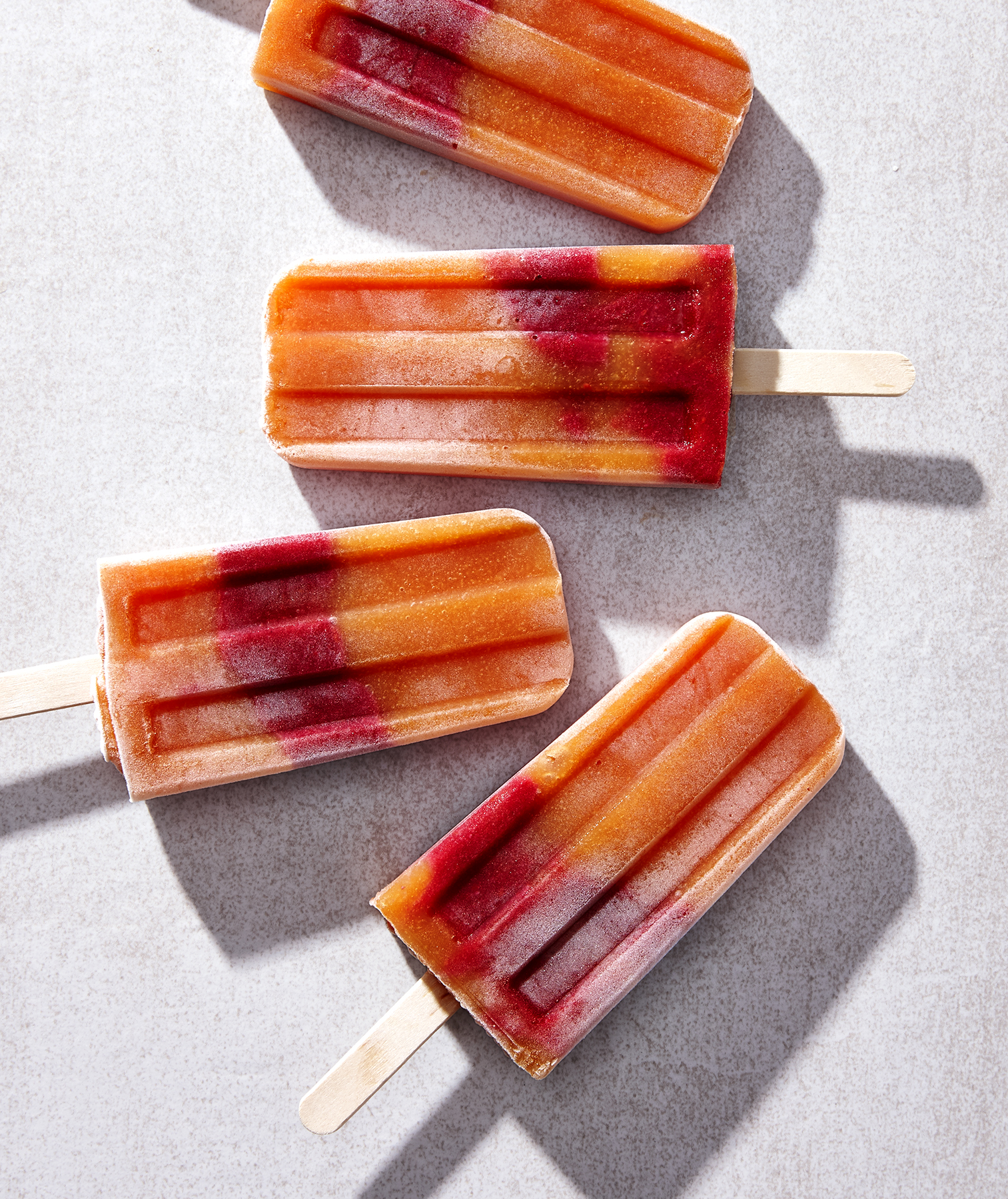Papaya-Raspberry Lime Pops
