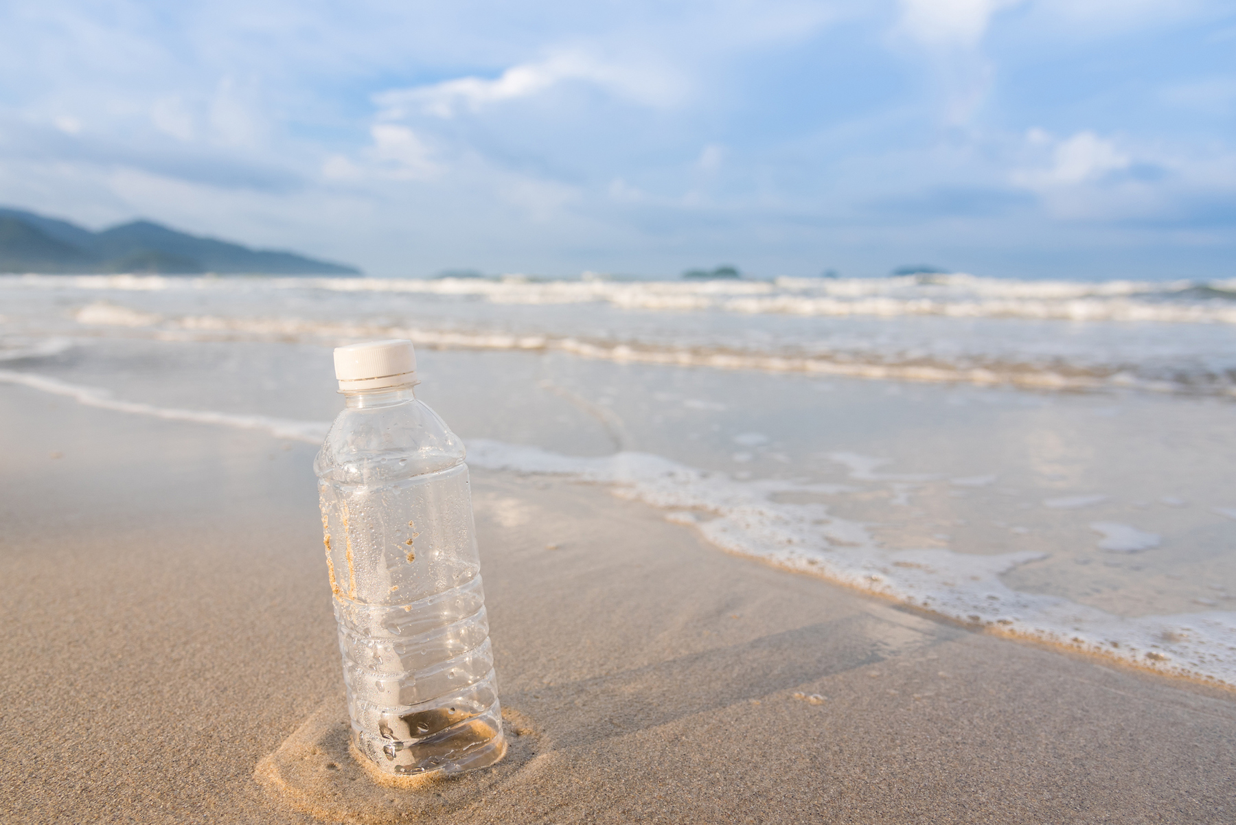 plastic water bottle on beach