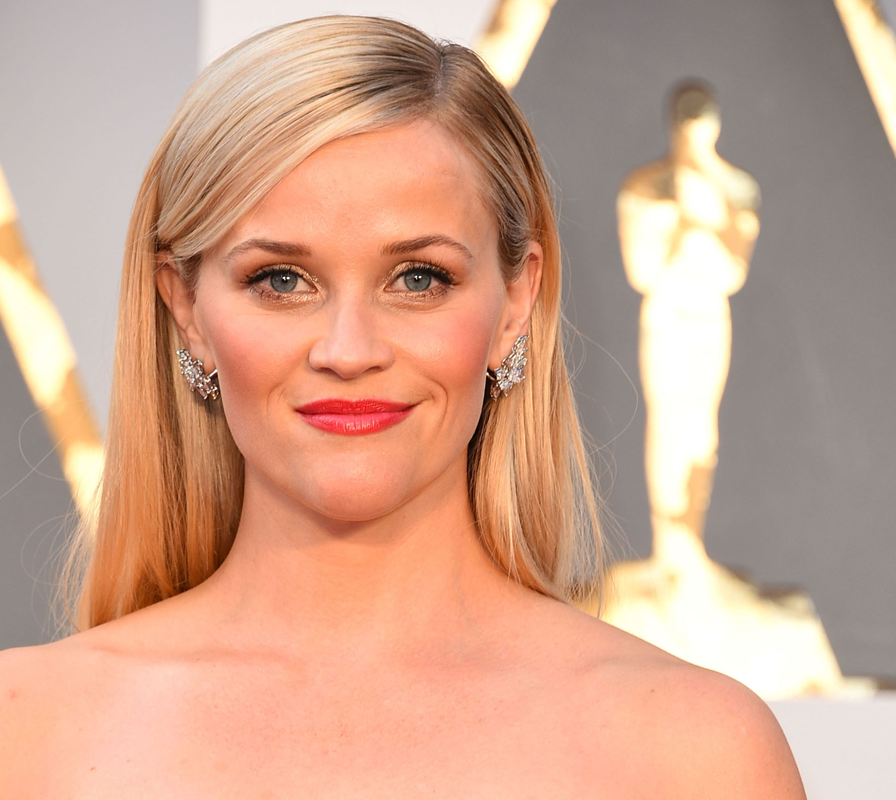 Reese Witherspoon Adopts a Blue-Eyed Bulldog Named Lou: 'Welcome to the Family'